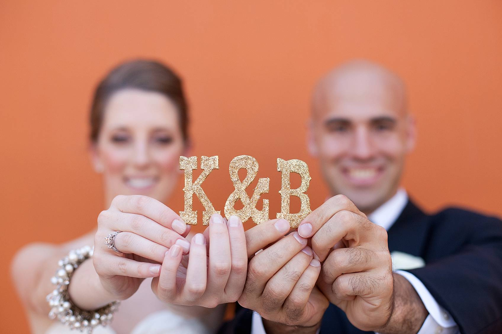 bride and groom holding initials