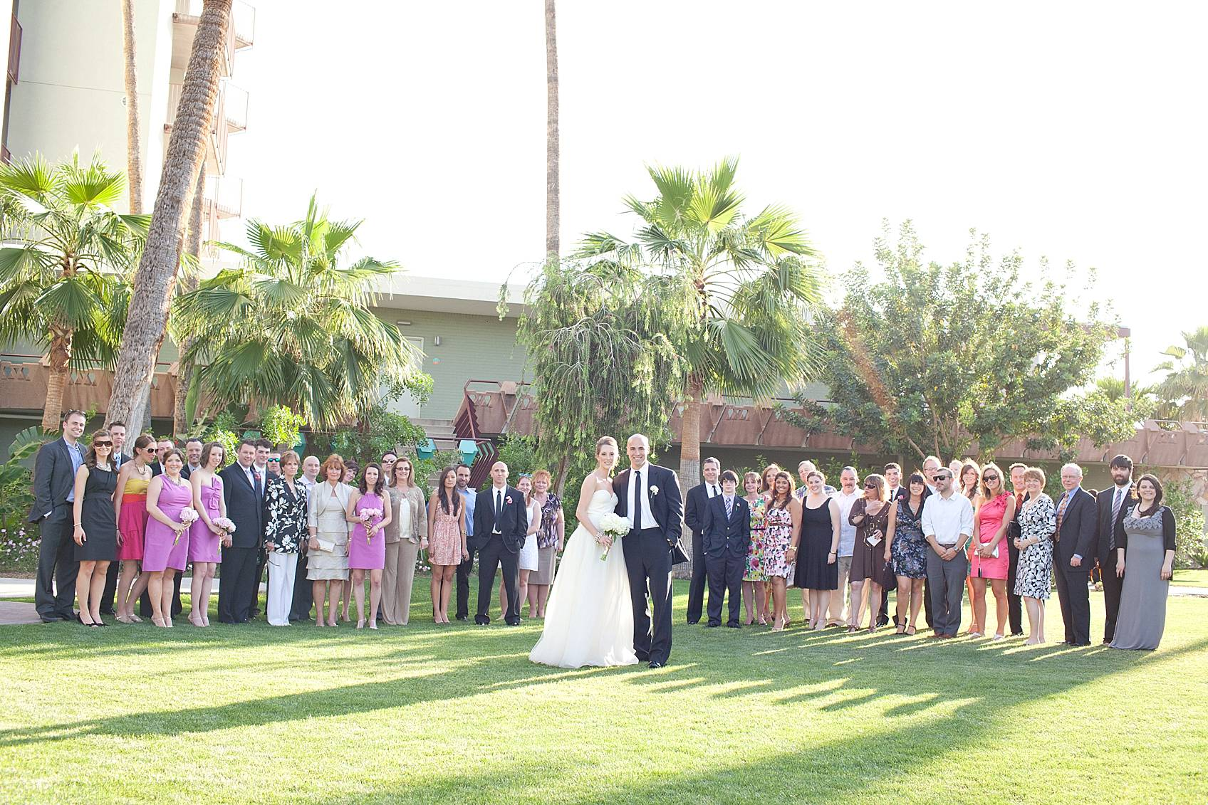 entire wedding guests behind bride and groom