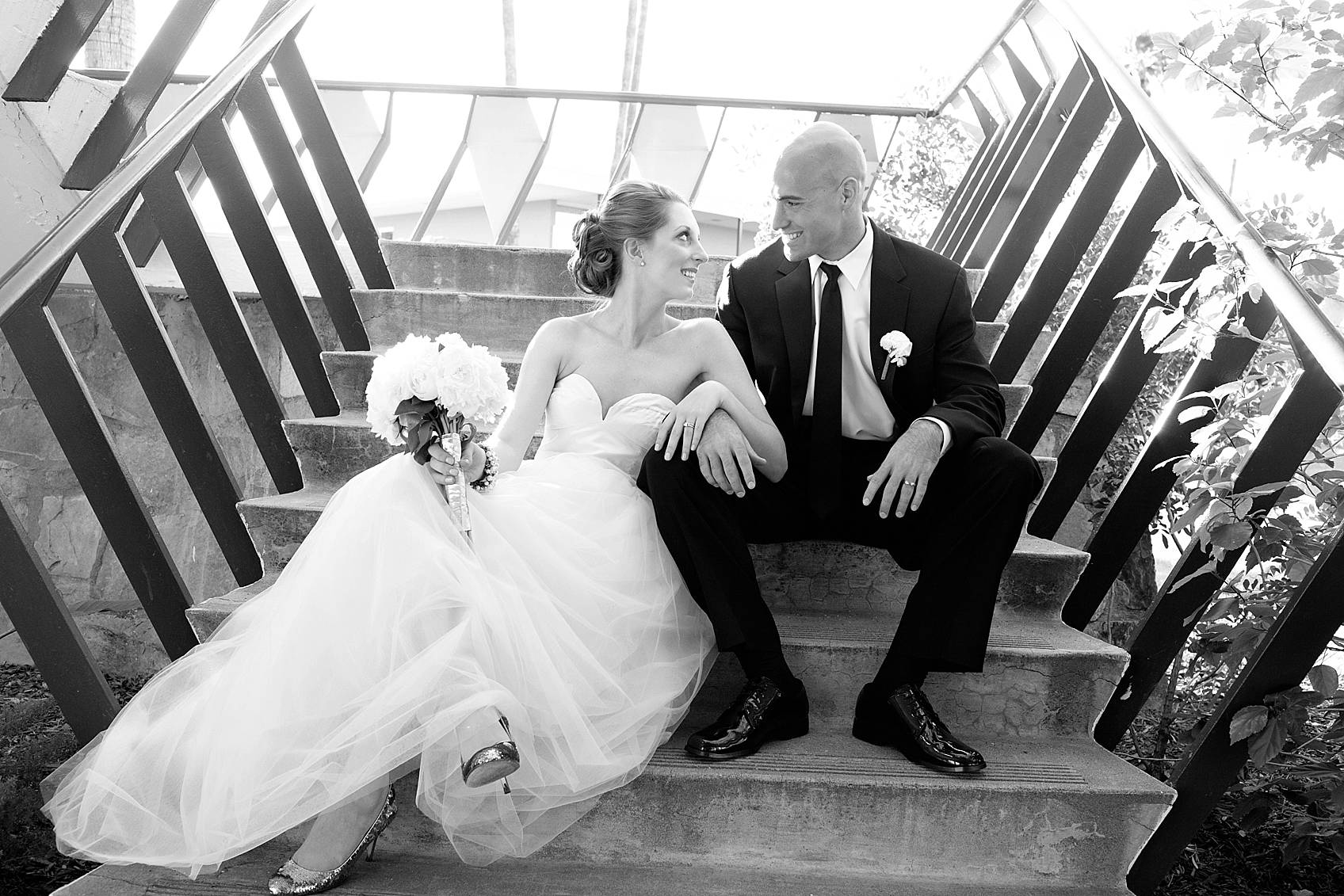bride and groom pose siting on stairs at hotel valley ho