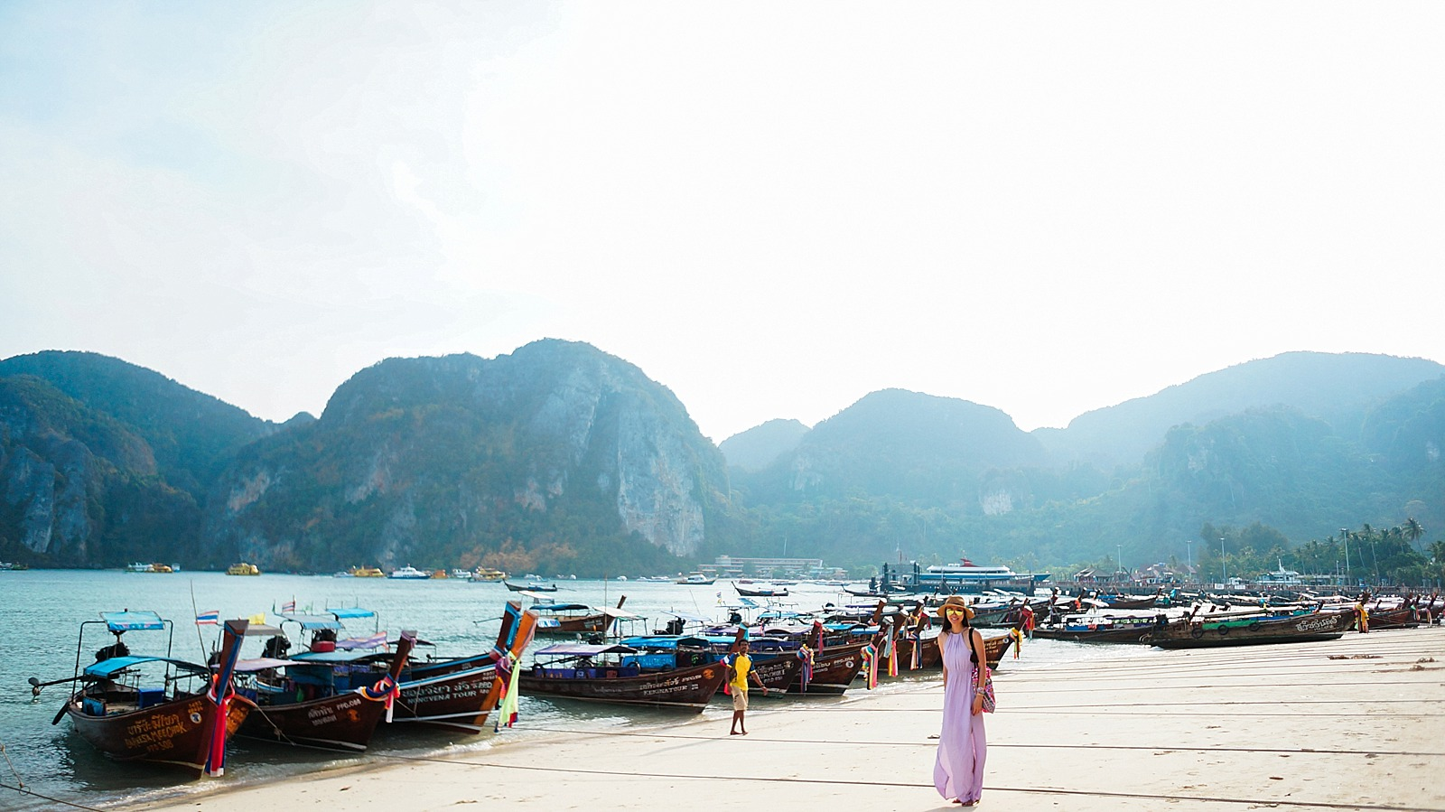 thailand diana elizabeth travel blogger in purple dress by the private long tails on Thailand phi phi islands