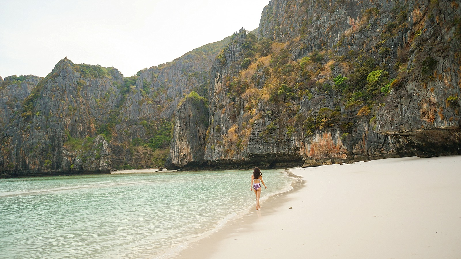Maya bay in Thailand phi phi islands diana elizabeth blogger wallking along shore line