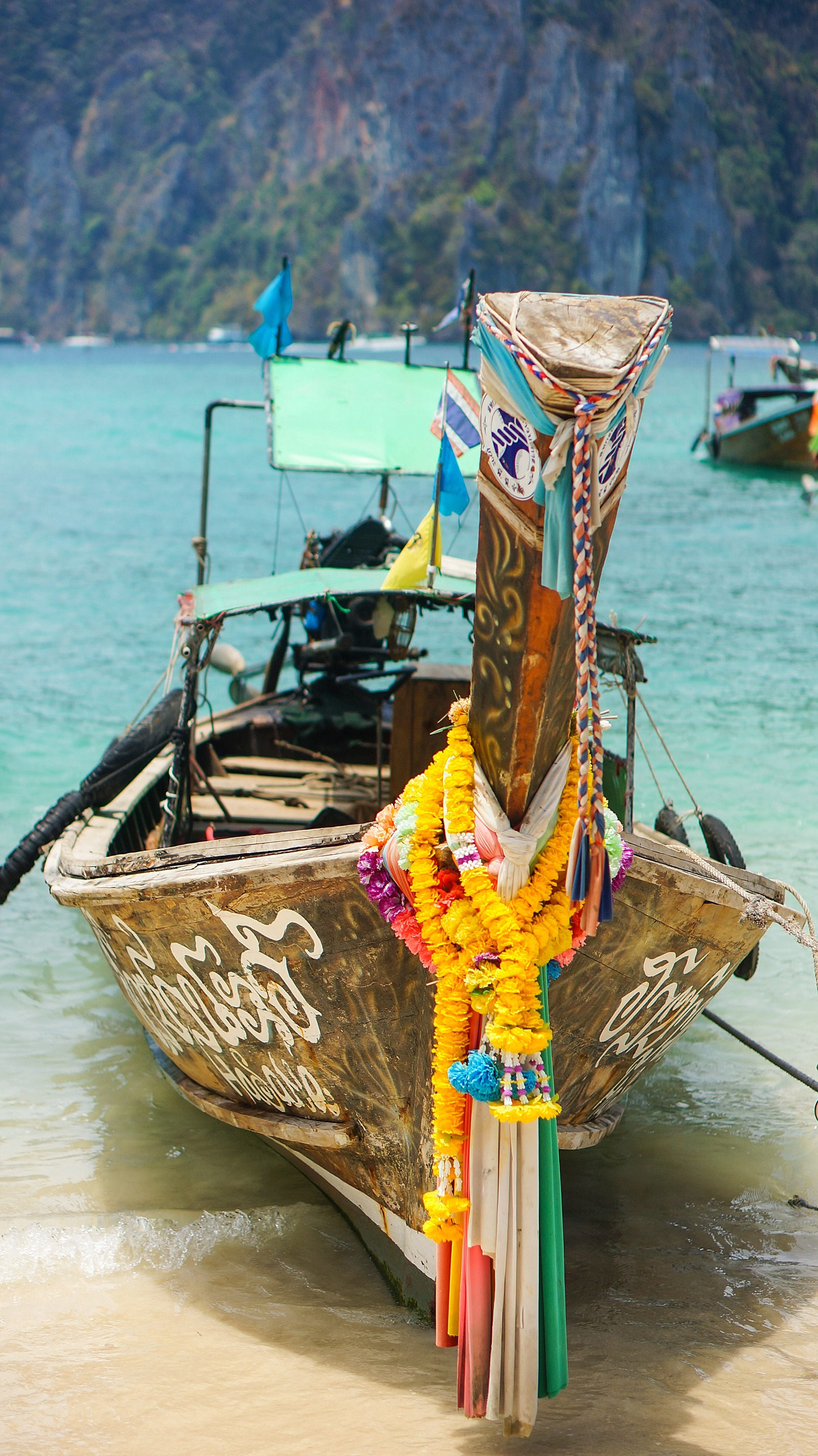 Thailand long tail pretty colors with flowers on phi phi islands