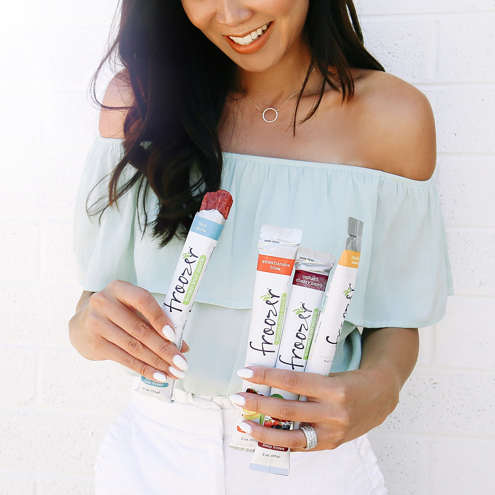 Diana Elizabeth lifestyle blogger in Phoenix holding Froozer pops natural flash frozen fruit popsicles