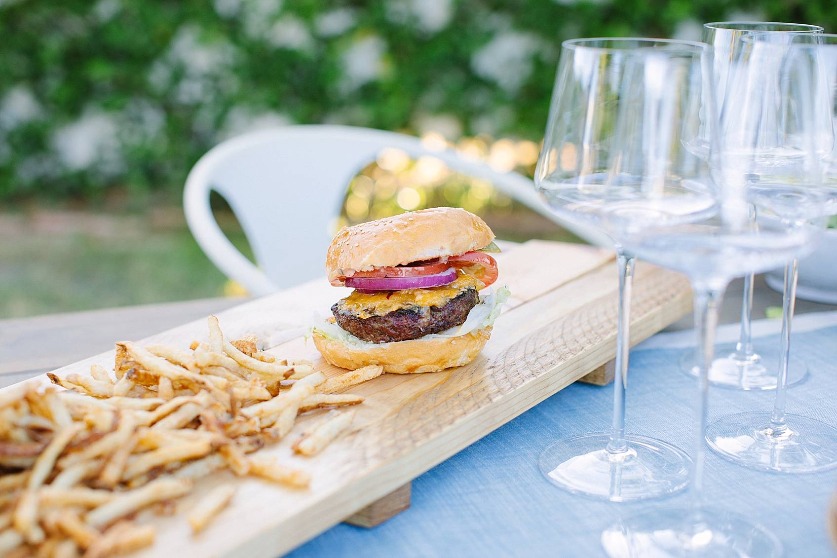 burger on a diy cheese board serving board for entertaining instructions in this post
