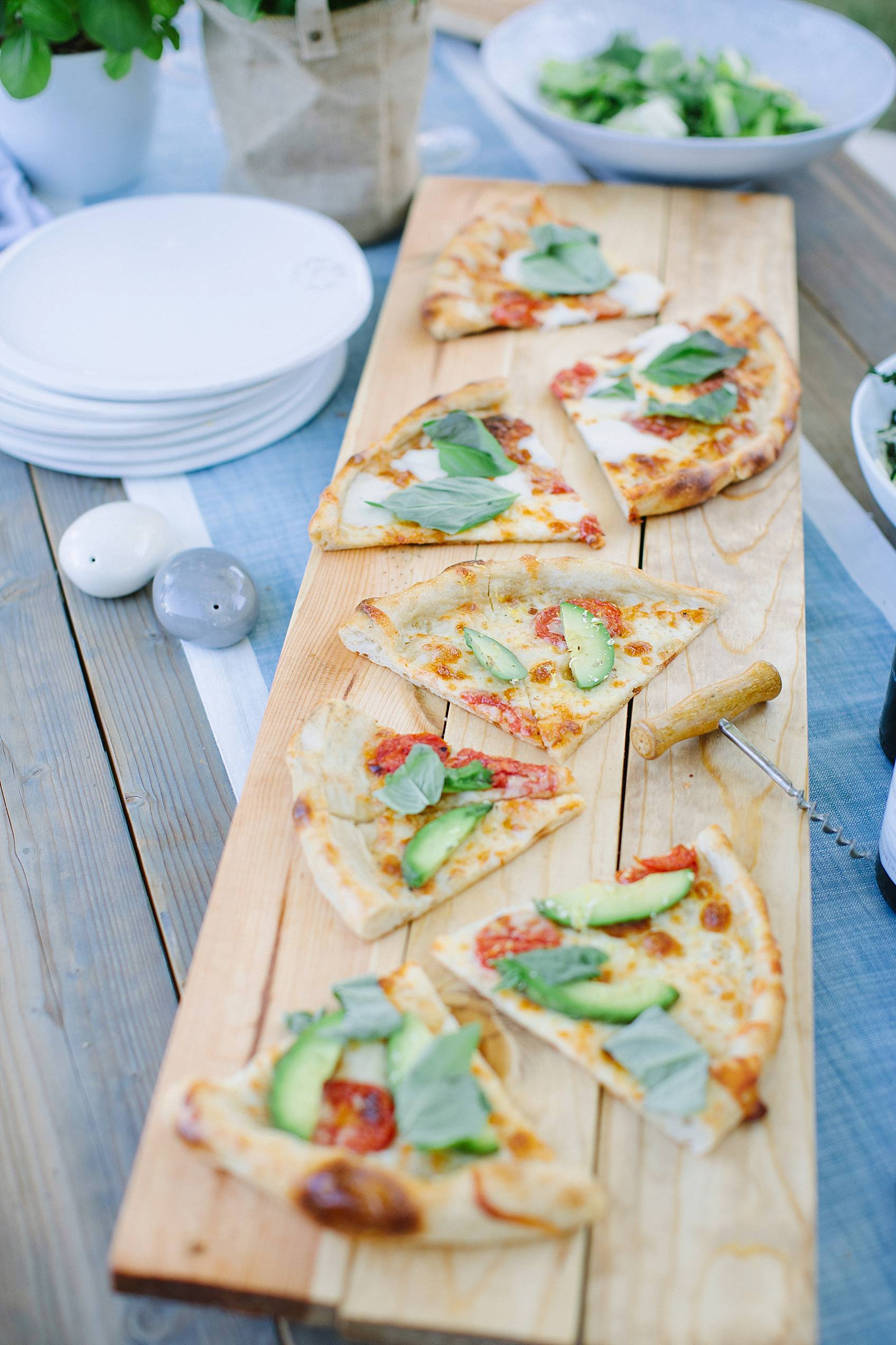 pizza on a diy cheese board serving board for entertaining instructions in this post
