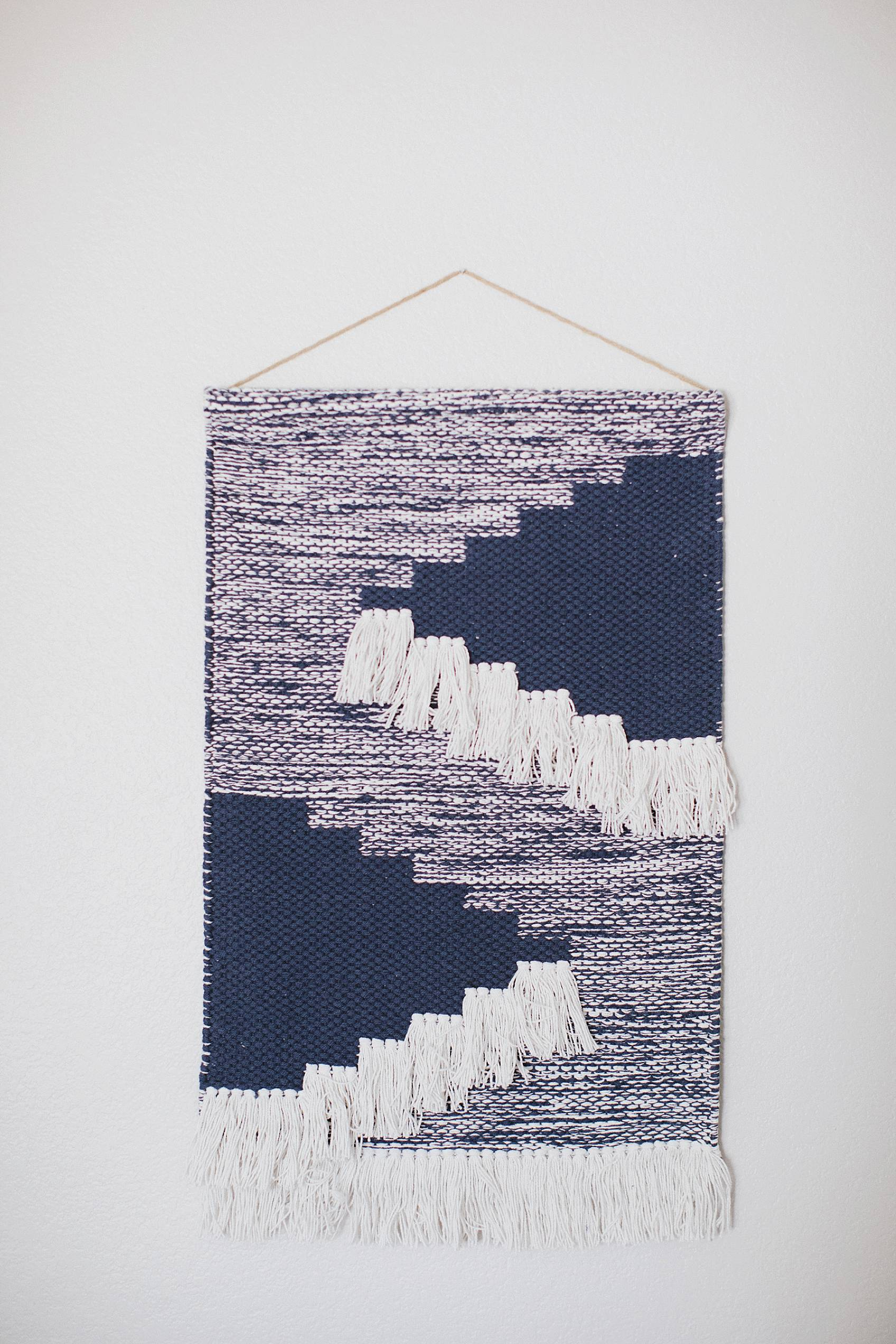 blue weaving on wall from Target