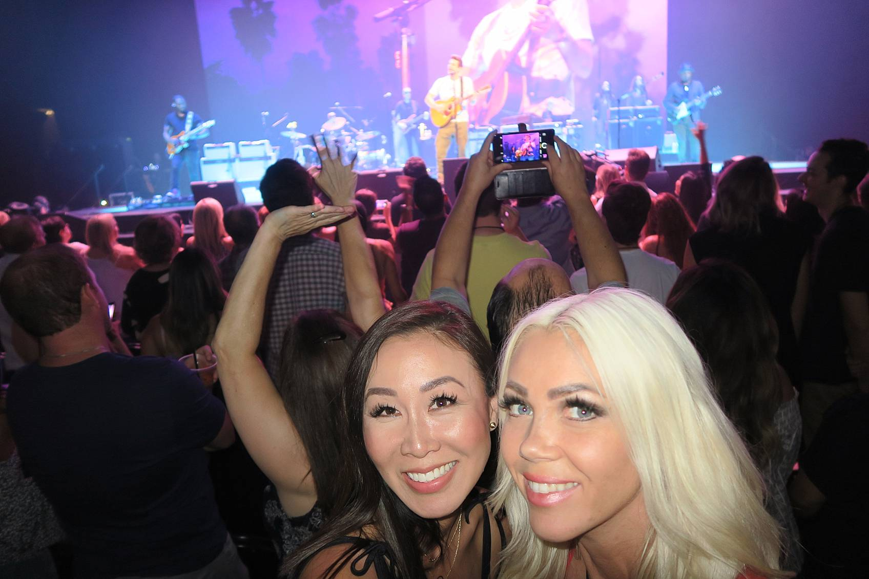 Selfie of Diana Elizabeth blogger and friend with John Mayer performing in Phoenix on stage for his The Search for Everything Tour in the background