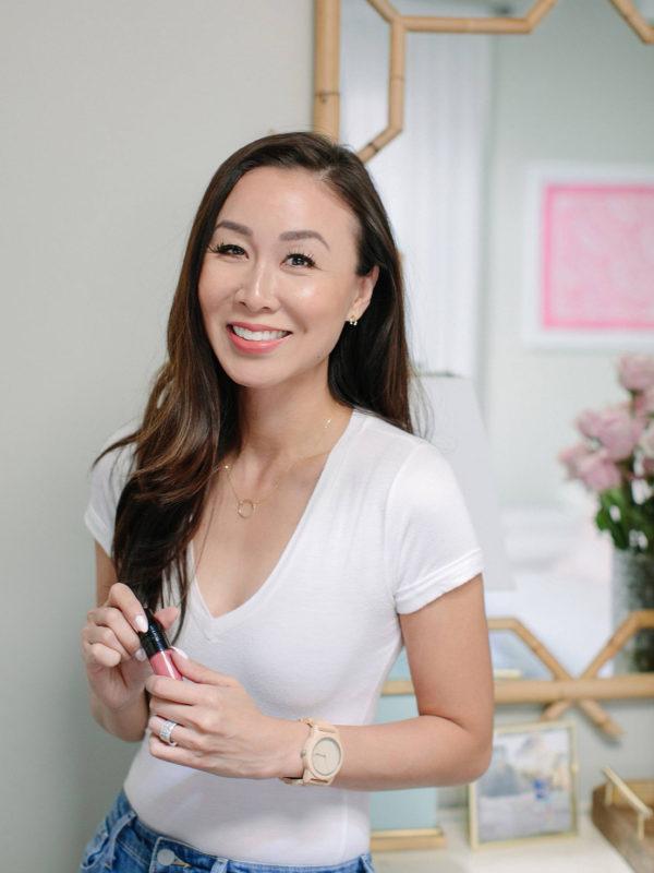 Diana Elizabeth lifestyle beauty blogger holding Lancome products