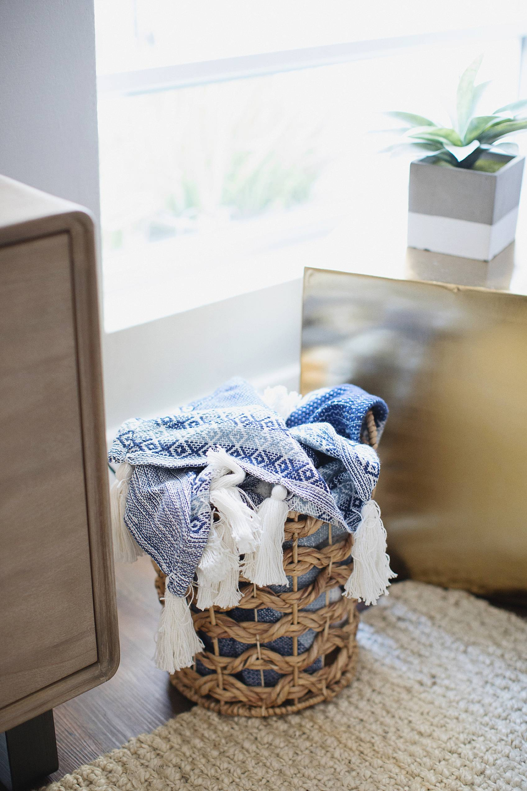 textured blanket in a basket showcase boho home trend