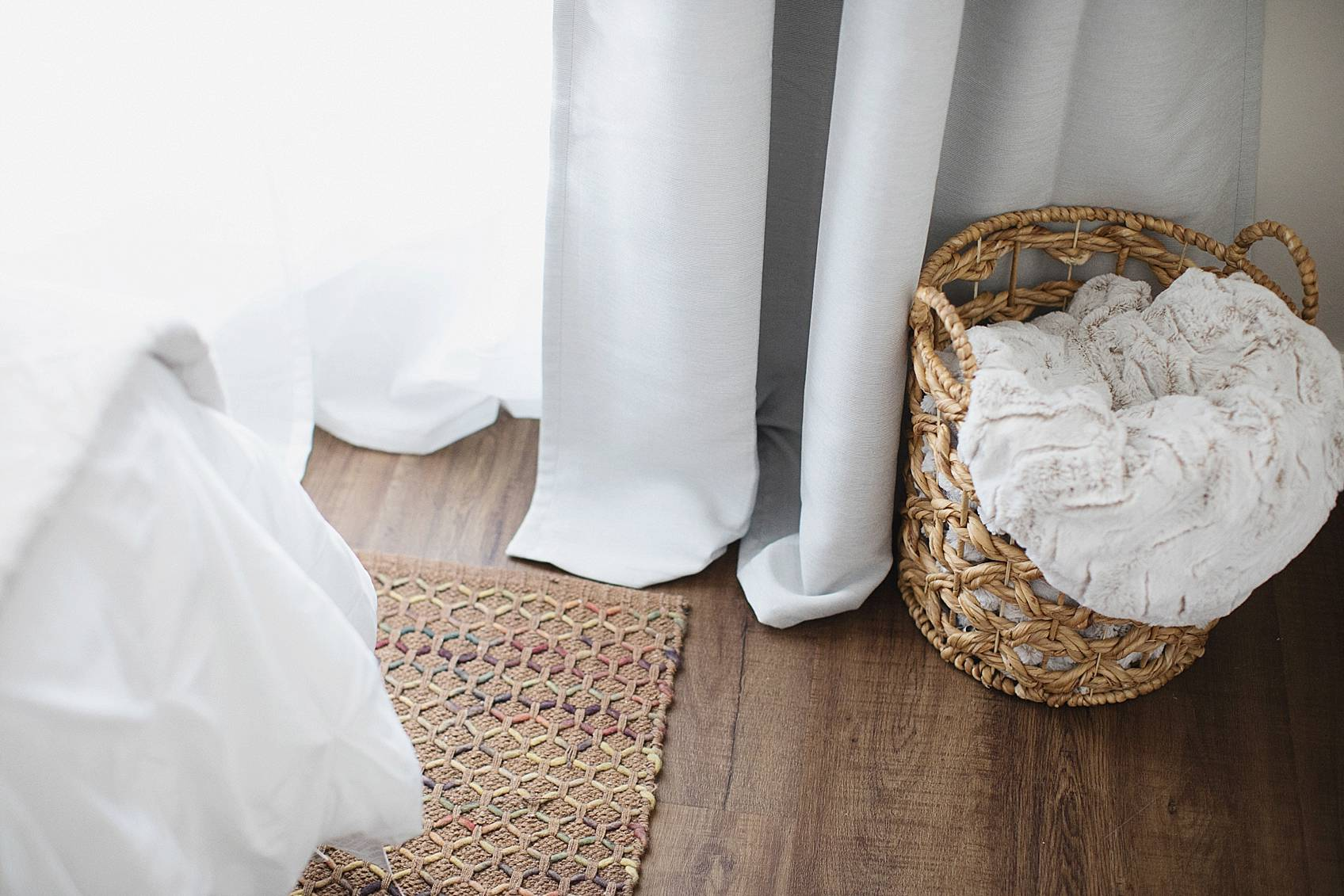 blanket in basket and rug to showcase textures and boho home trend