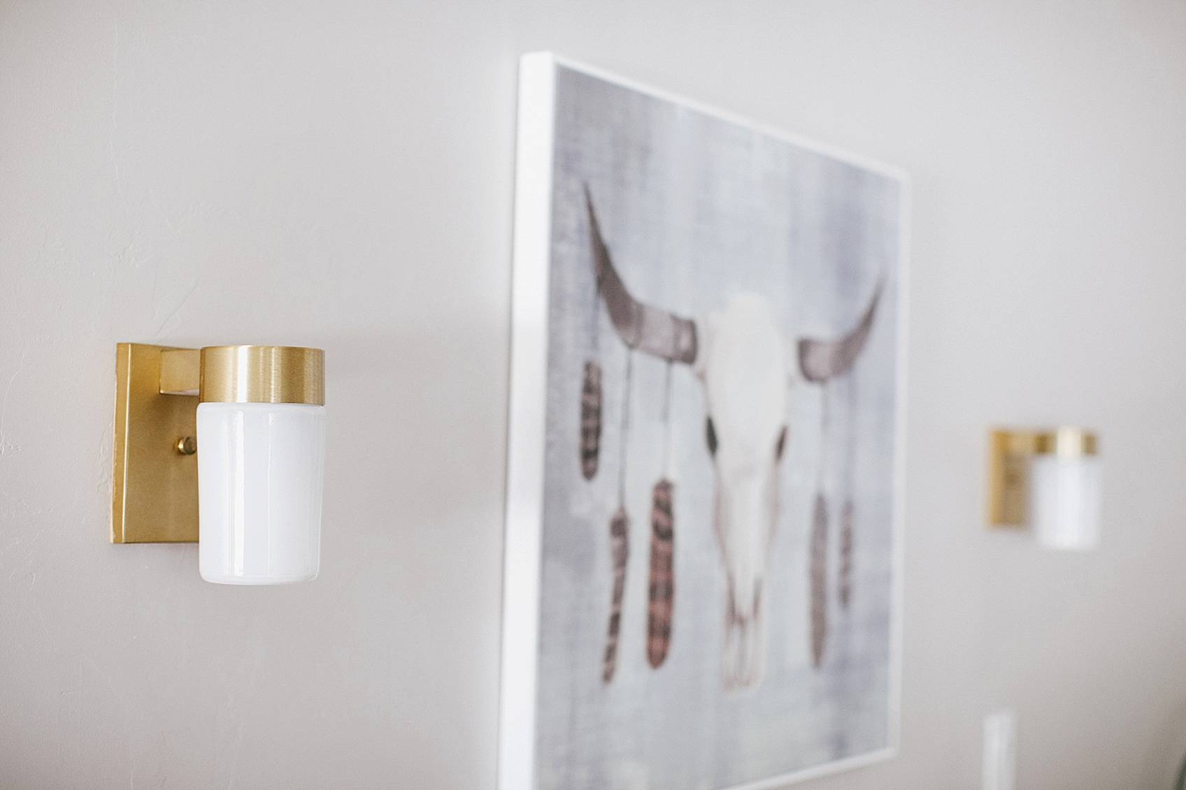 brass lights and cow skull showcase boho home trend