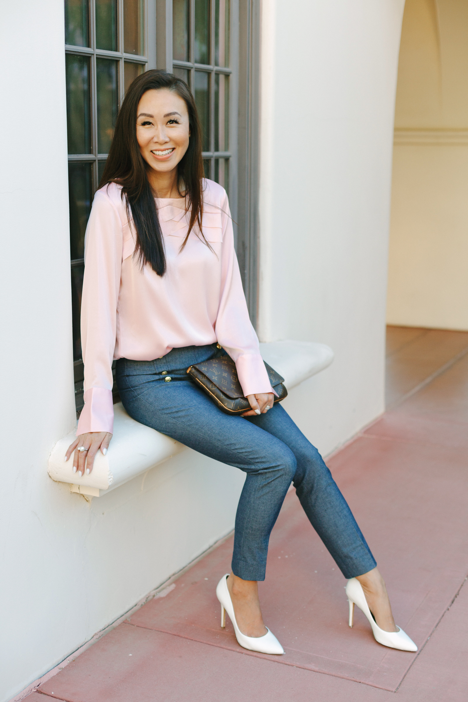 phoenix lifestyle blogger diana Elizabeth sitting on window sill wearing banana republic sailor pants and blush ruffle top and white pumps