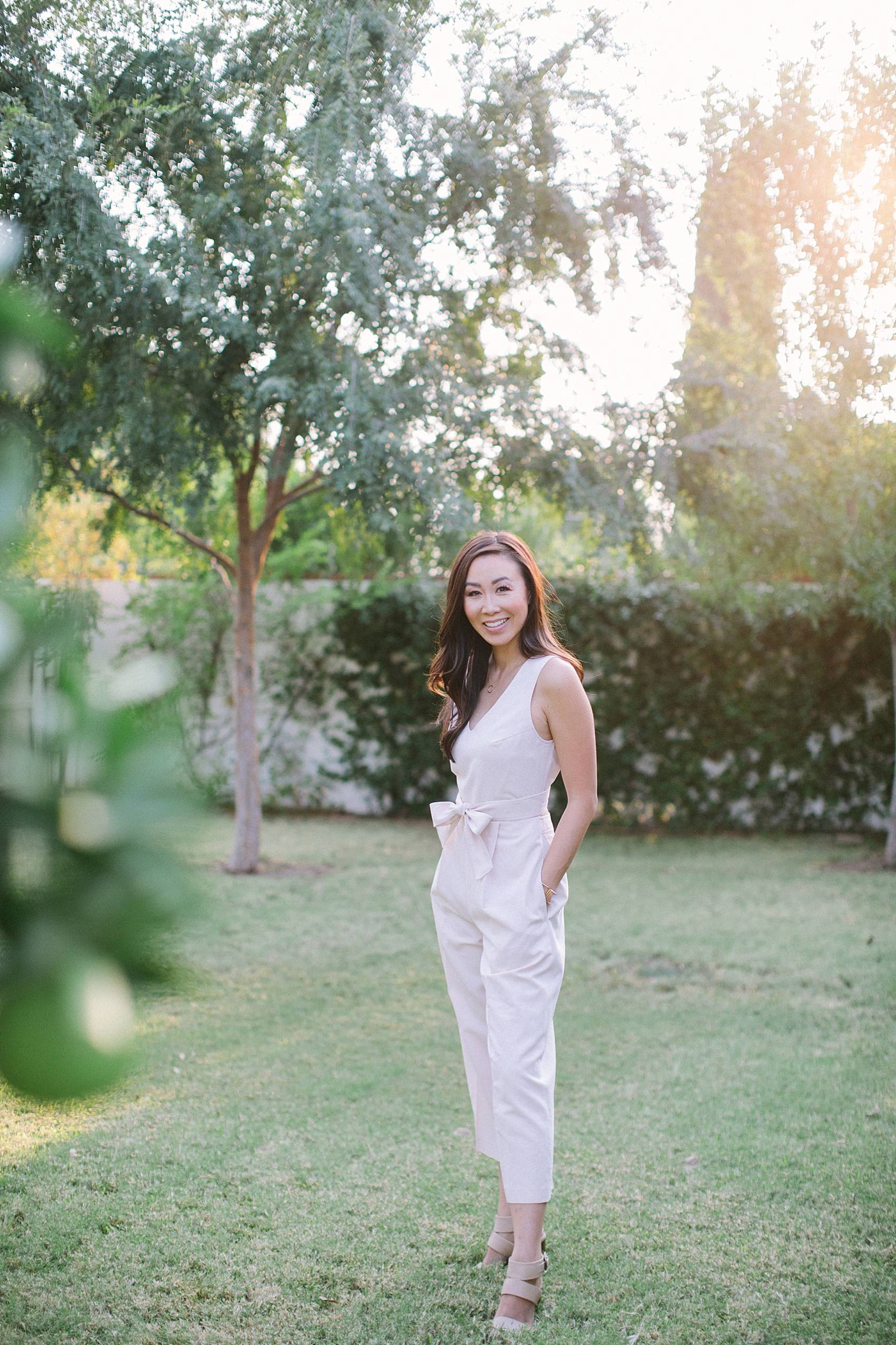 Diana Elizabeth lifestyle blogger wearing blush club Monaco jumpsuit