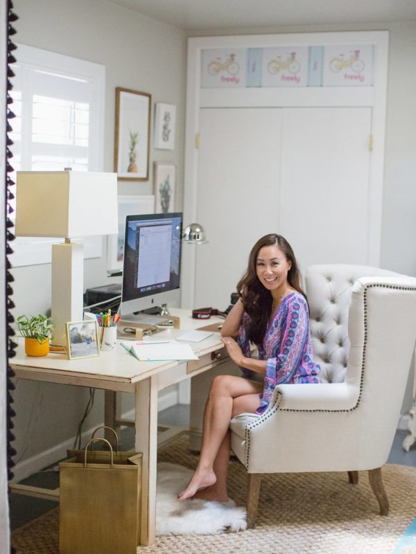 diana Elizabeth lifestyle blogger sitting in chair in home office
