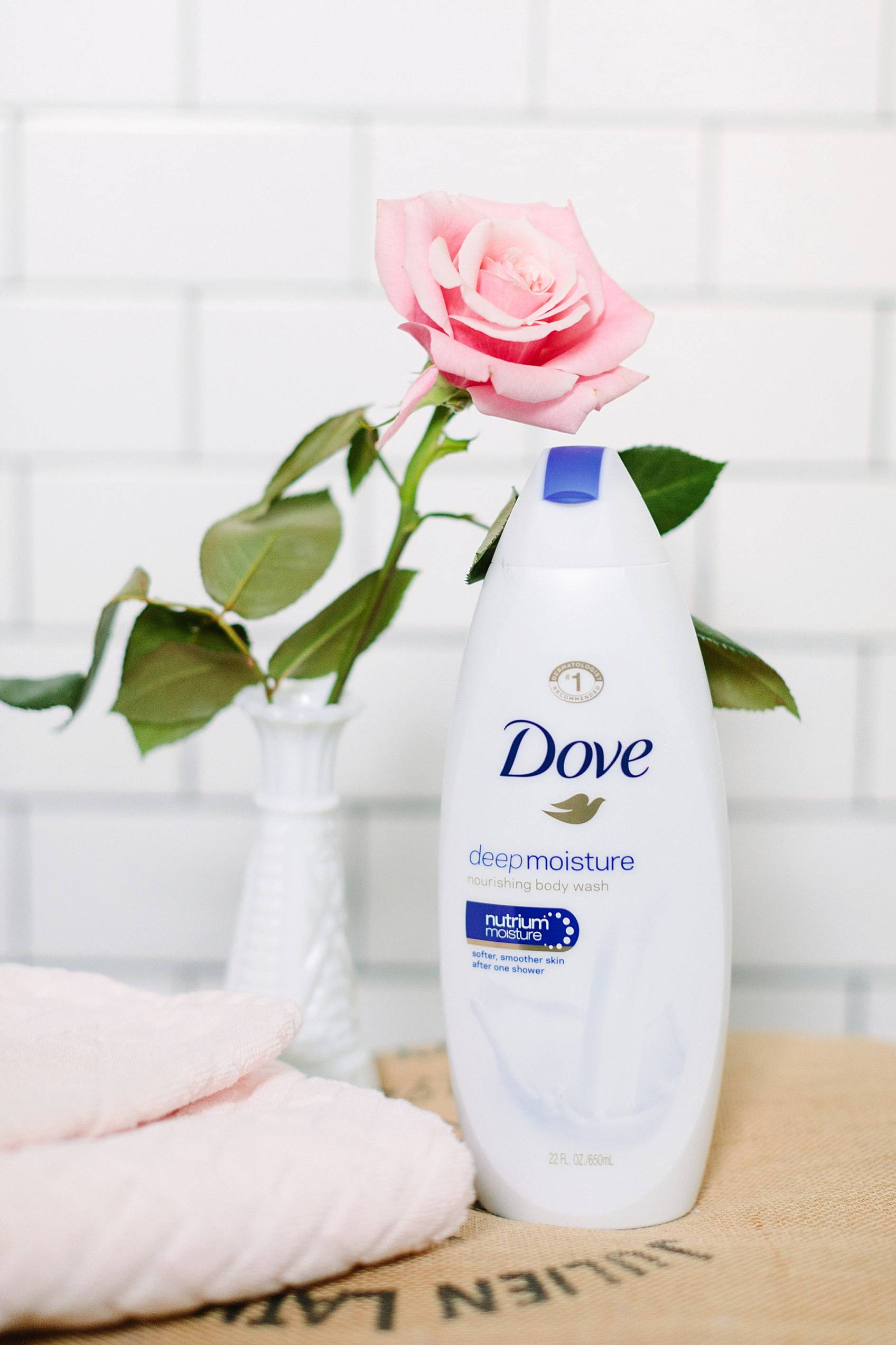 dove beauty shower wash on stool with rose