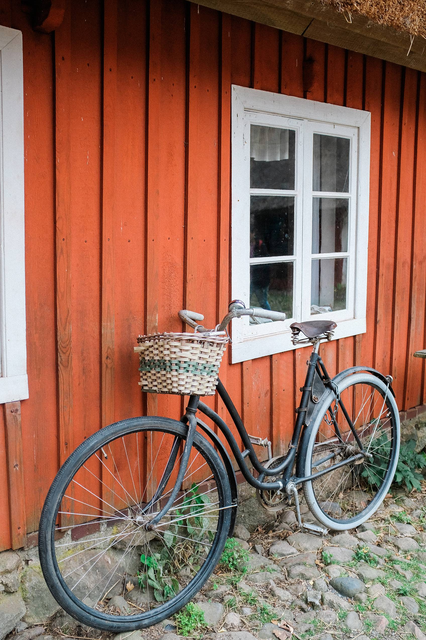 Photo tour of Stockholm: green bike leaning against red home in skansen