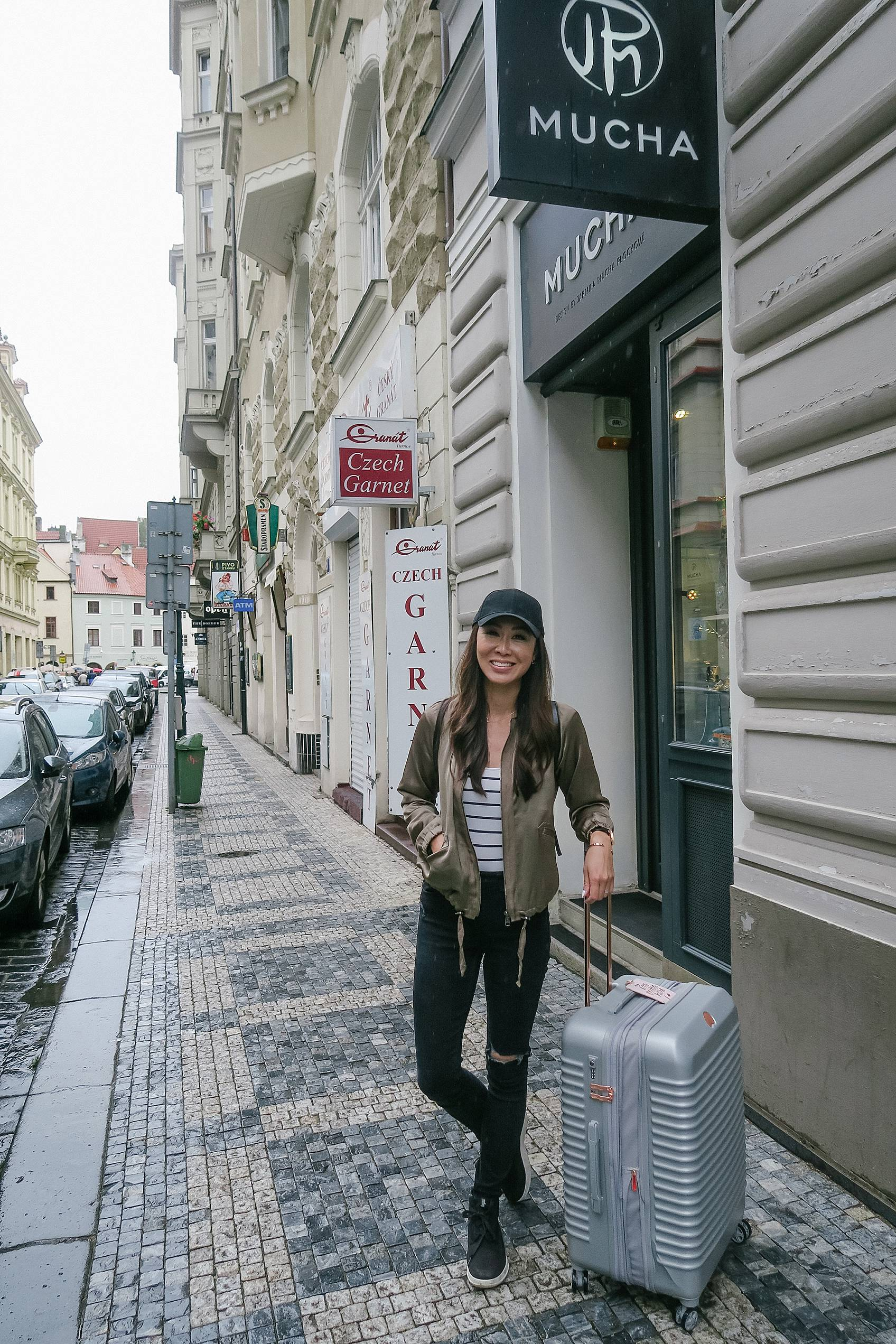 lifestyle travel blogger diana Elizabeth on streets of Prague with luggage