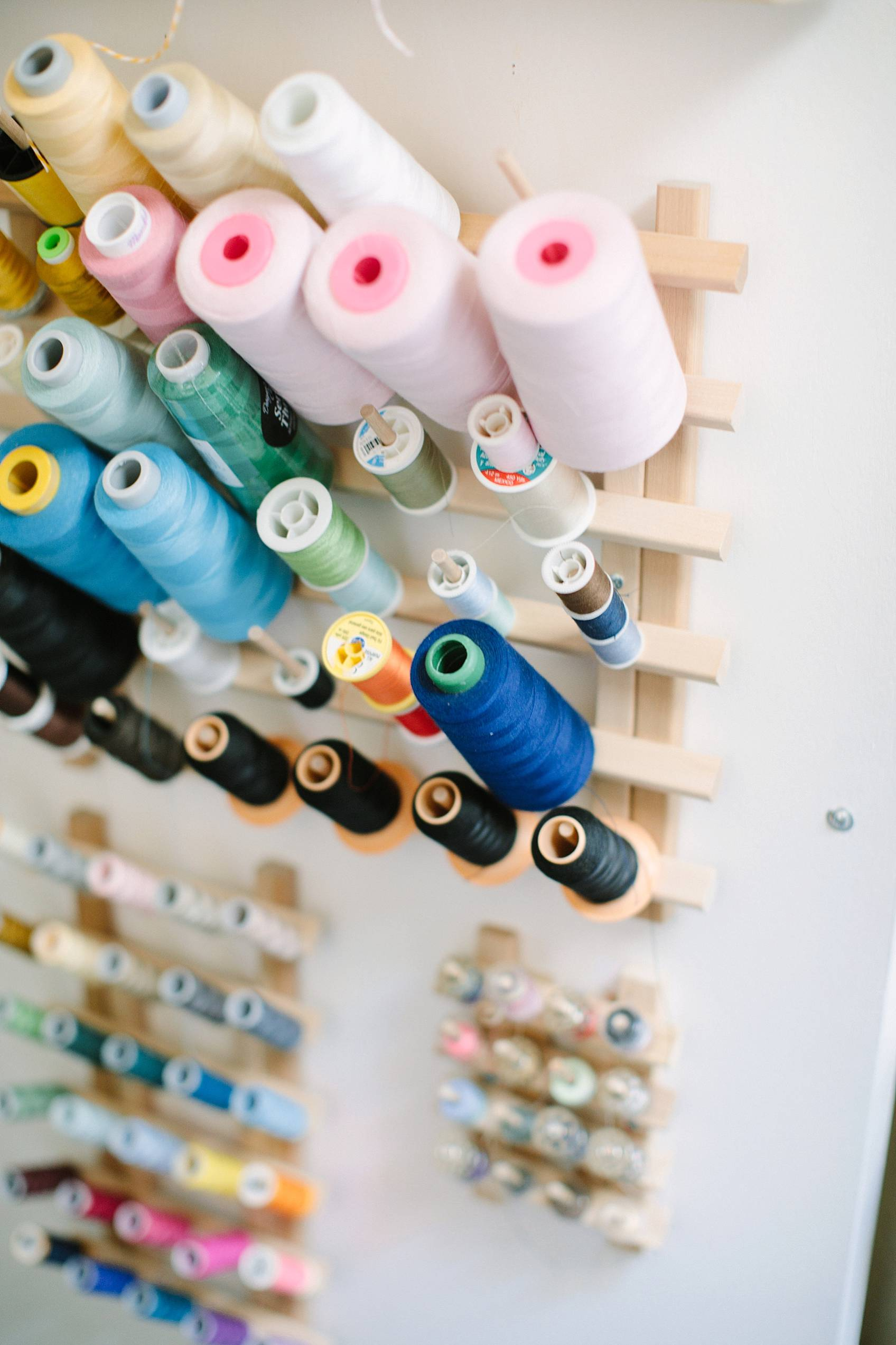 spools of colorful thread mounted