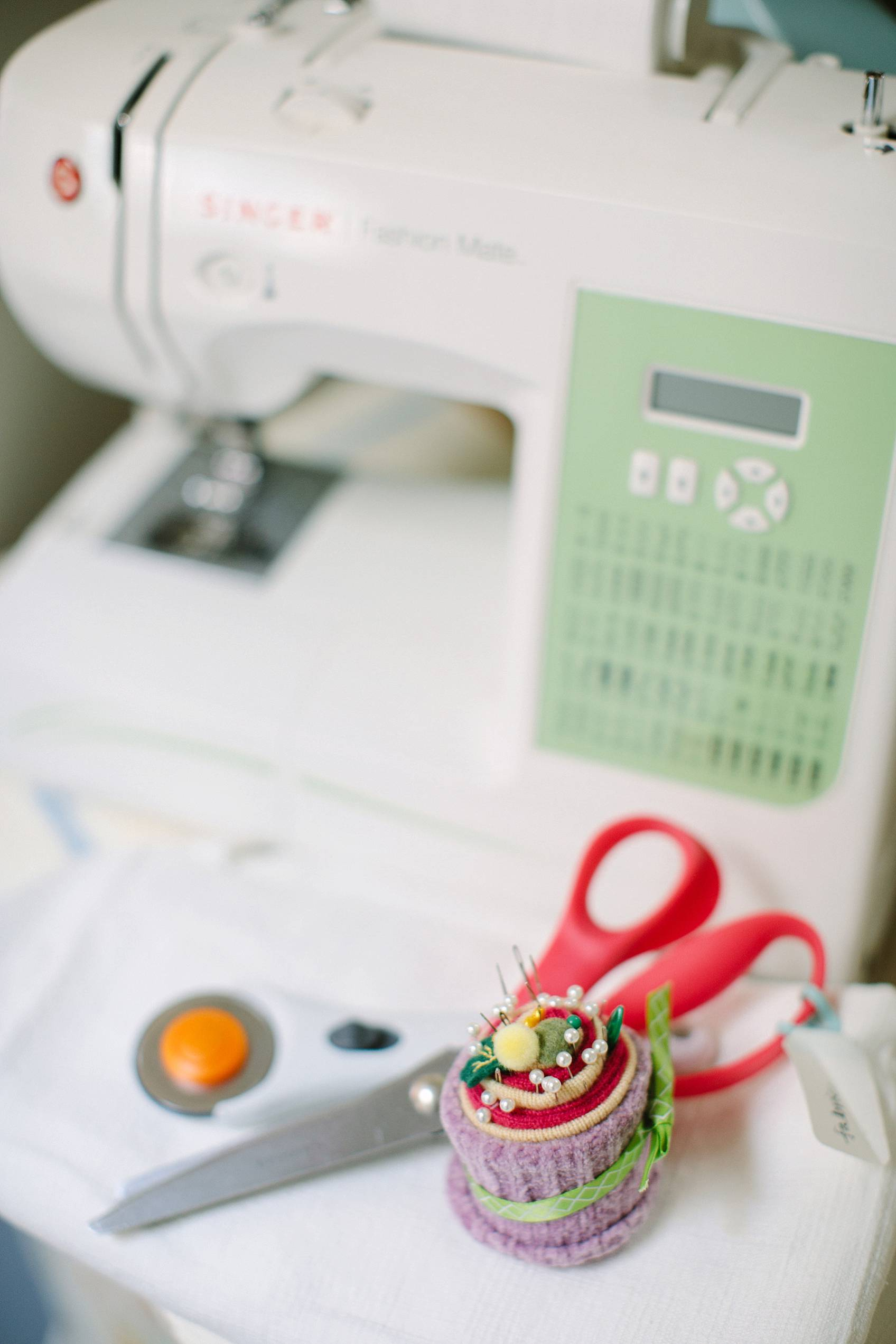 sewing machine with fabric scissors and fabric cuter and pin cushion