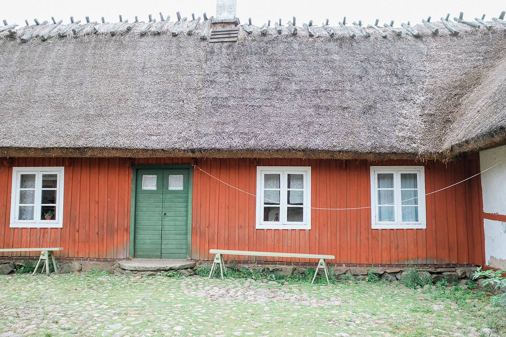 skansen stockholm cottage living decor for inspiration, red house with green door