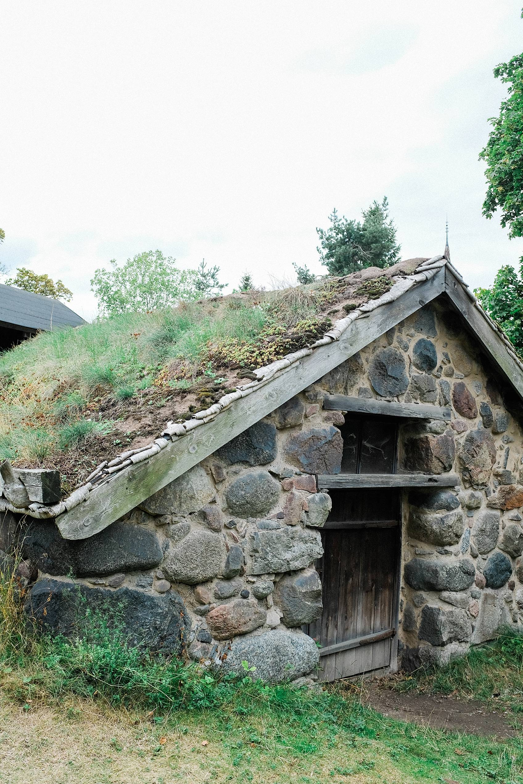 skansen stockholm cottage living decor for inspiration, stone small cottage with plants on roof
