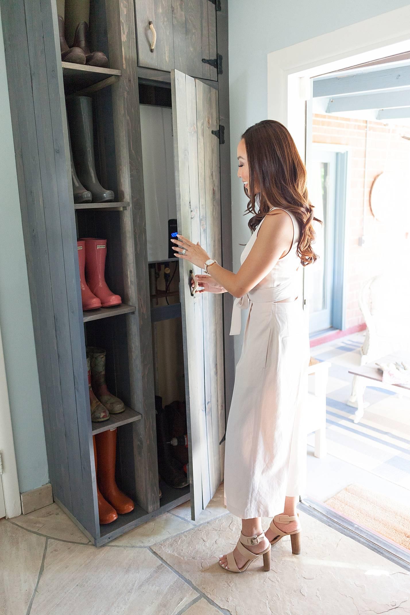 custom cabinet to reveal hidden tankless water heater in mudroom laundry room hide