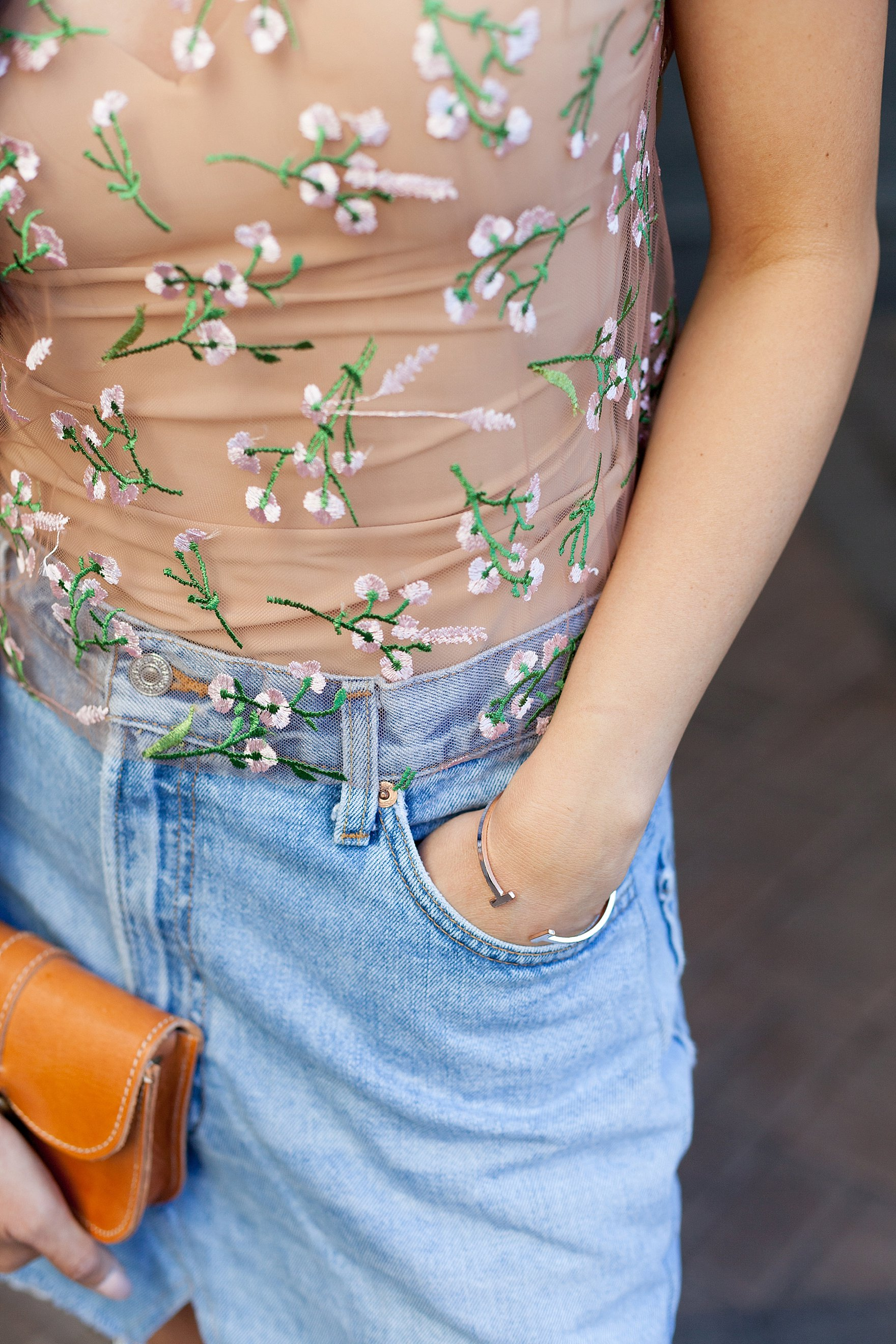 embroidery shirt from urban outfitters with denim skirt