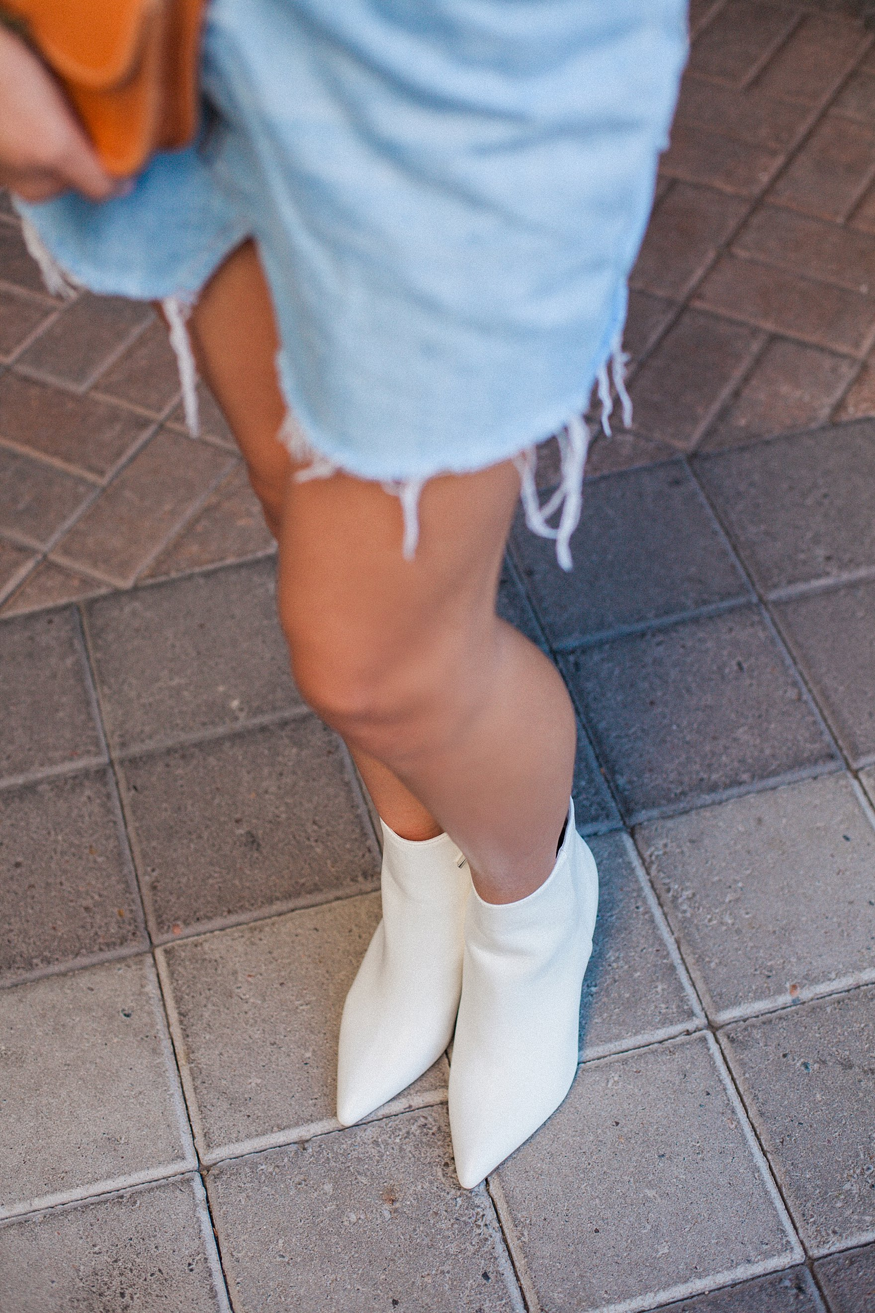 embroidery shirt from urban outfitters with denim skirt with white ankle booties