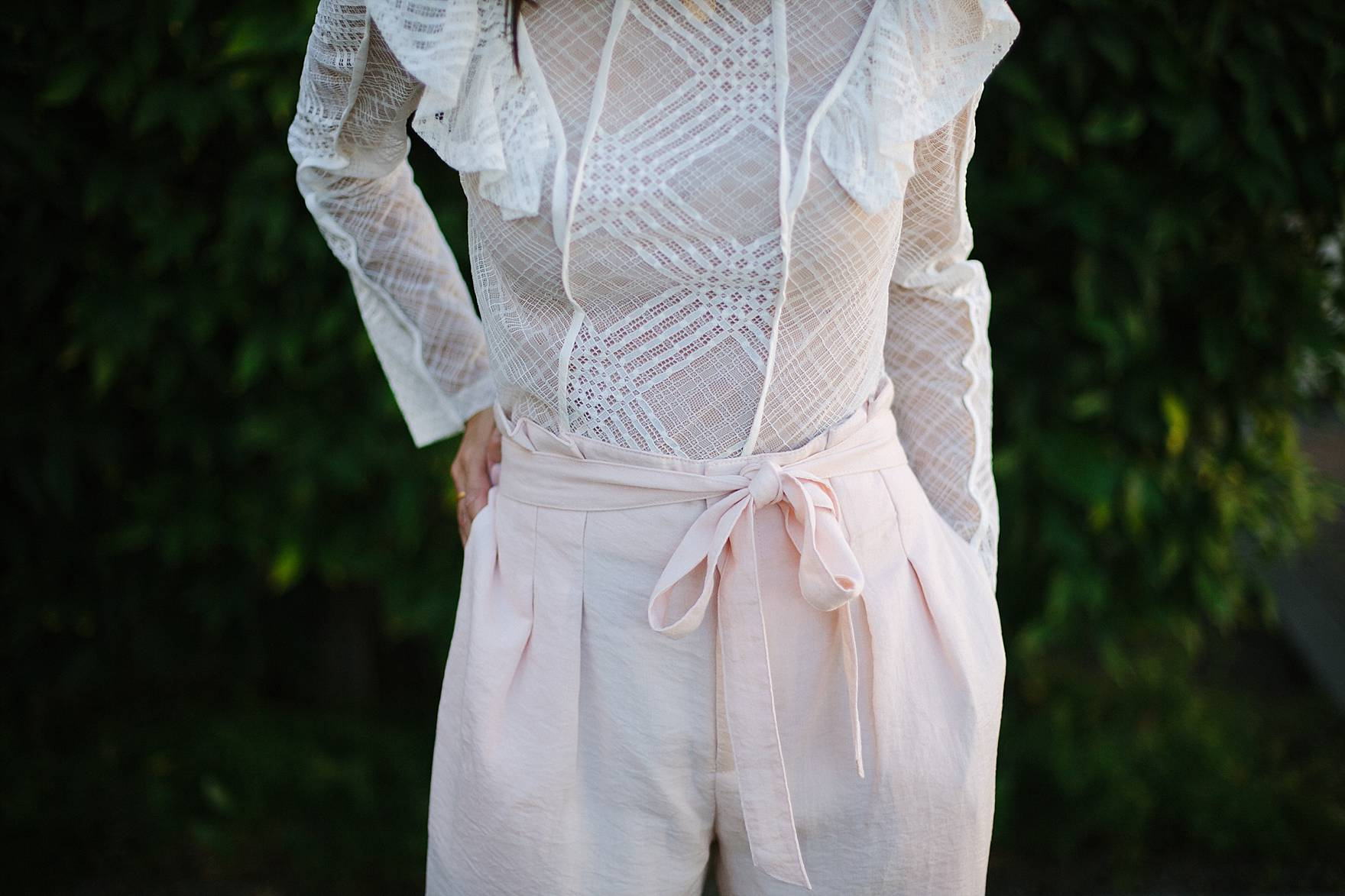 Leia Pant blush pant by Club Monaco with white ruffle top on blogger Diana Elizabeth
