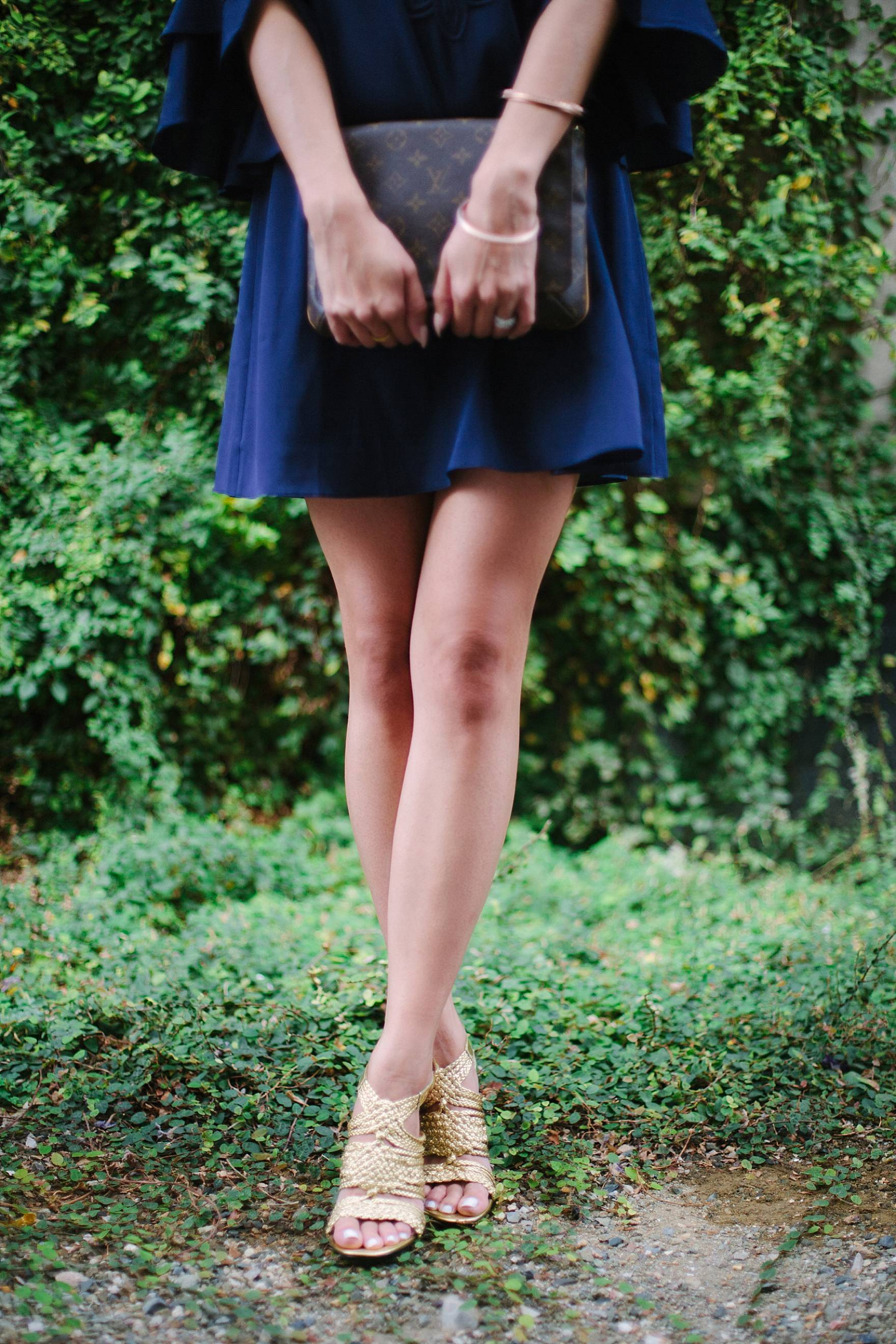 Lilly Pulitzer blue Tatiana Stretch Silk Tunic Dress on lifestyle blogger Diana Elizabeth in front of climbing vines