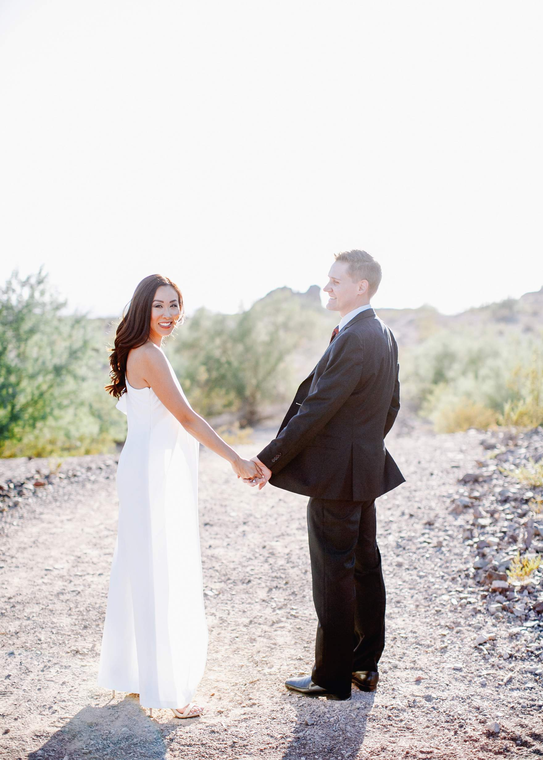 Diana Elizabeth blogger with husband Benjamin Christmas photos in the desert wearing white jumpsuit Arizona 2017