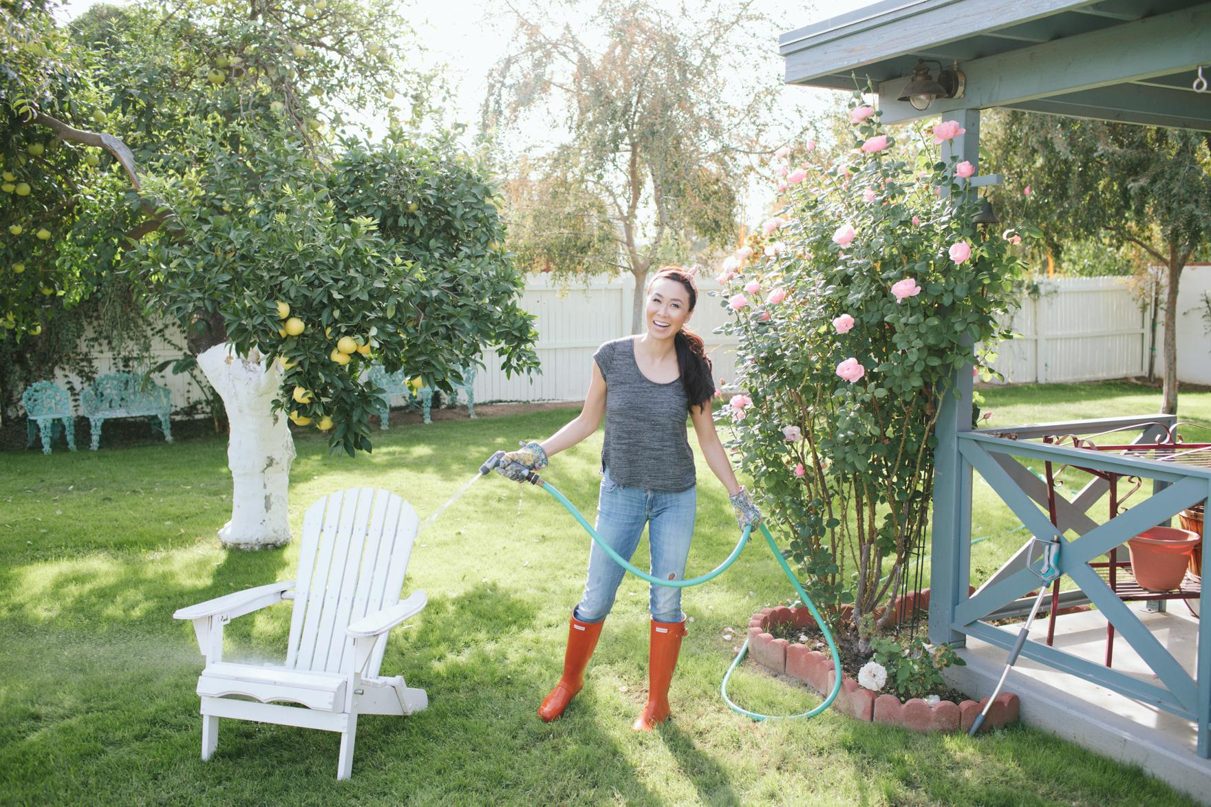 clean outside of your home windows brick stucco and concrete patio and driveway with Gilmour spray hose and pressure washer featuring Diana Elizabeth lifestyle garden blogger