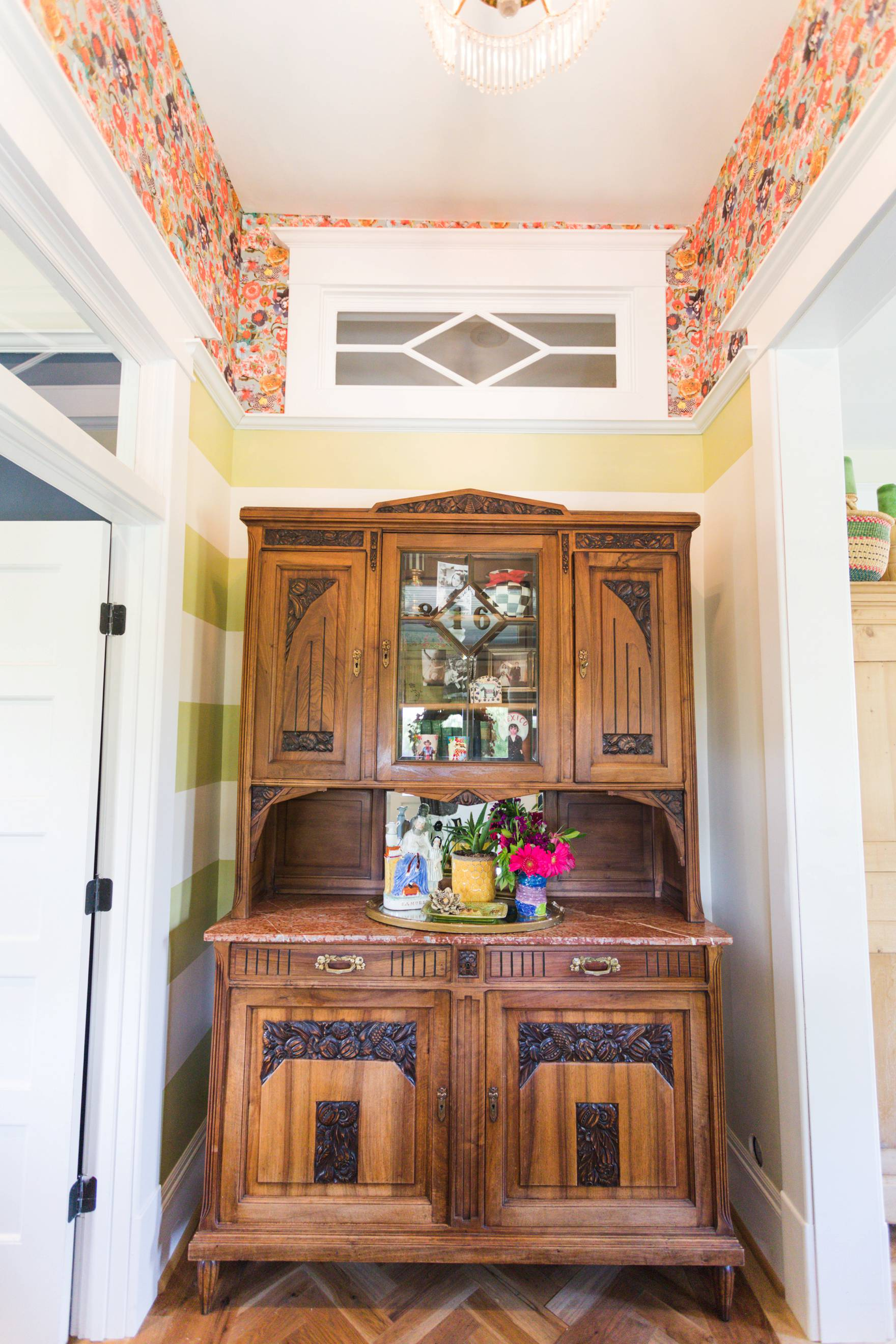 Home Tour of Boho Farm and Home in Downtown Phoenix - cottage brick style home from 1903 // entry way details transom and wallpaper for top half of wall.