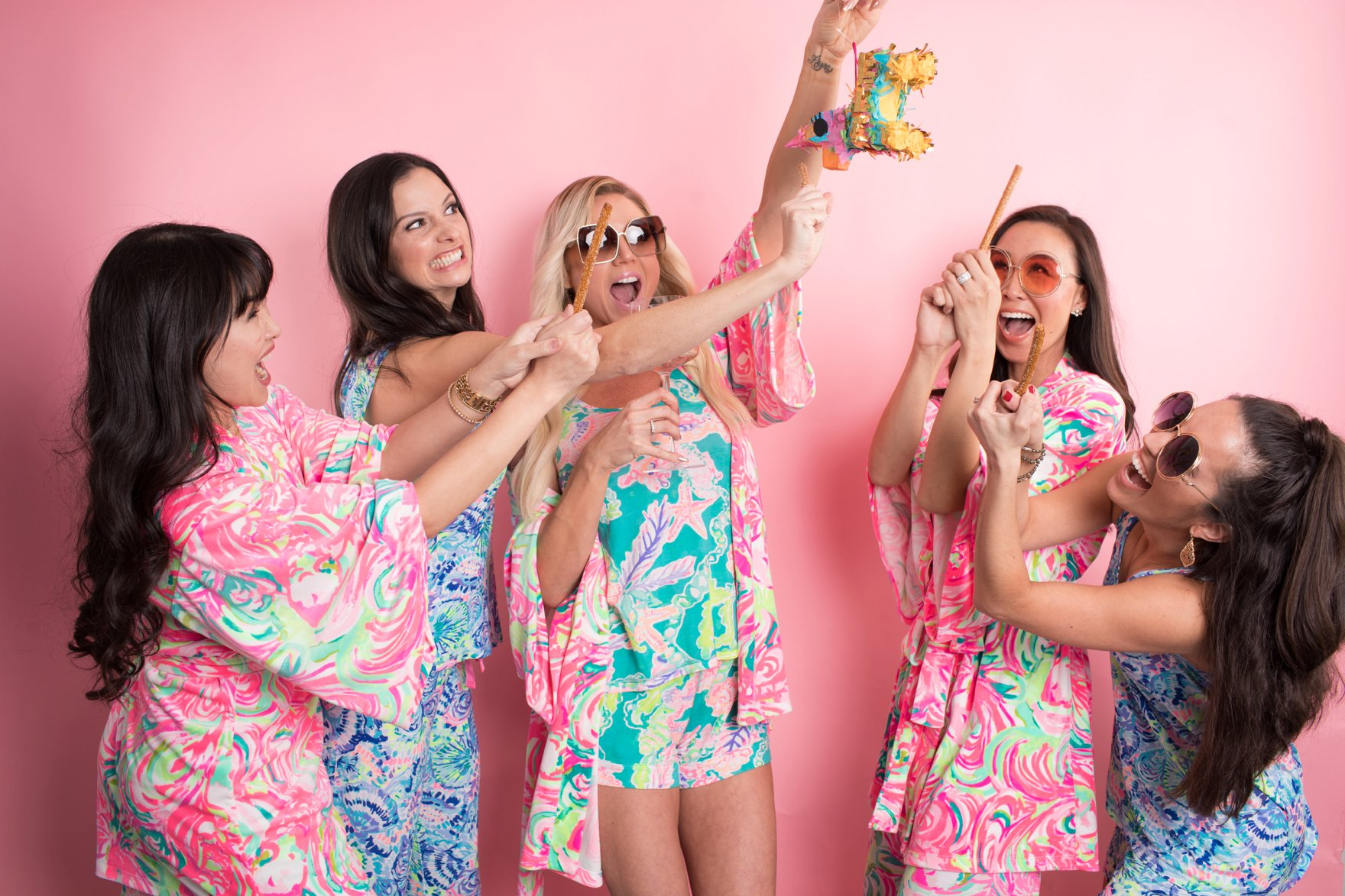 Lilly Pulitzer Christmas pajama party playing piñata