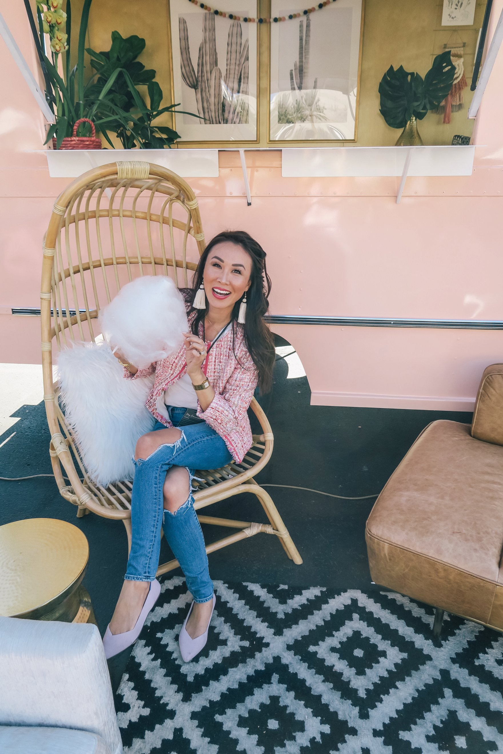 sitting in the peach az restored truck in pink boucle jacket ripped jeans and holding cotton candy // a business and blogging social media workshop called The Workshop PHX by the Bloguettes - a review.