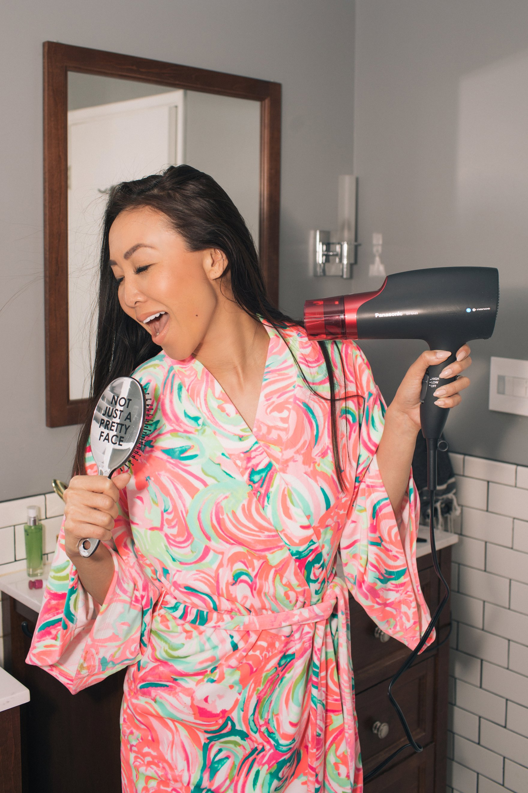 Featuring Panasonic nanoe™ hair dryer wearing pink robe