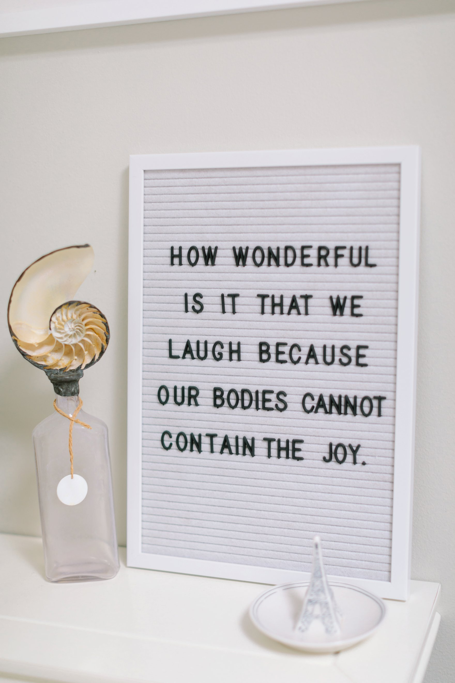 felt sign how wonderful is it that we laugh because our bodies cannot contain the joy