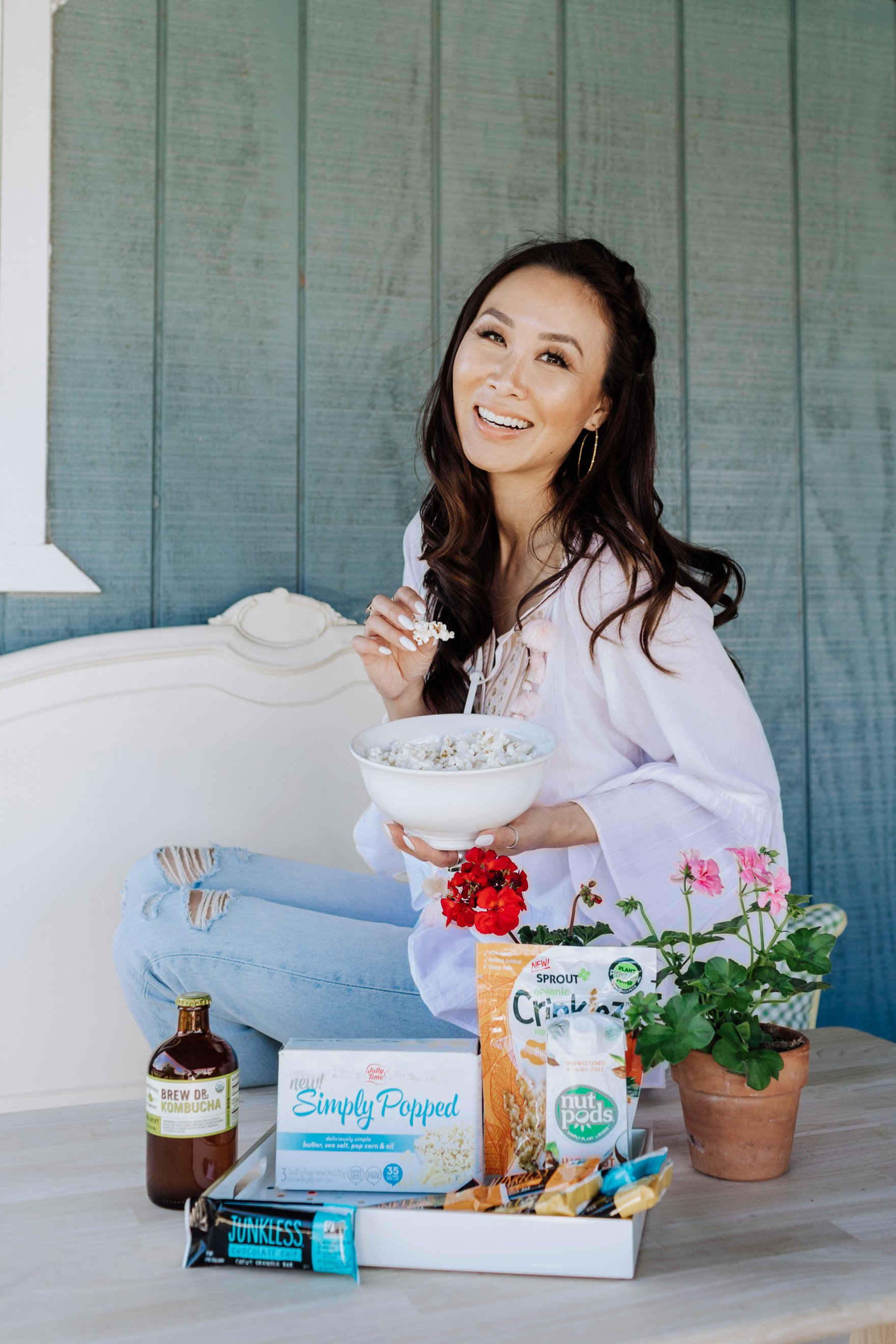 Diana Elizabeth sitting on the table with babbleboxx latest good for you things to eat discover on the blog
