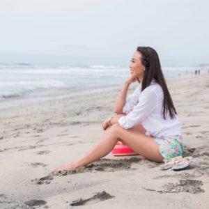 Carlsbad state beach wearing Lilly Pulitzer ocean view boardshort Diana Elizabeth blogger sitting on beach