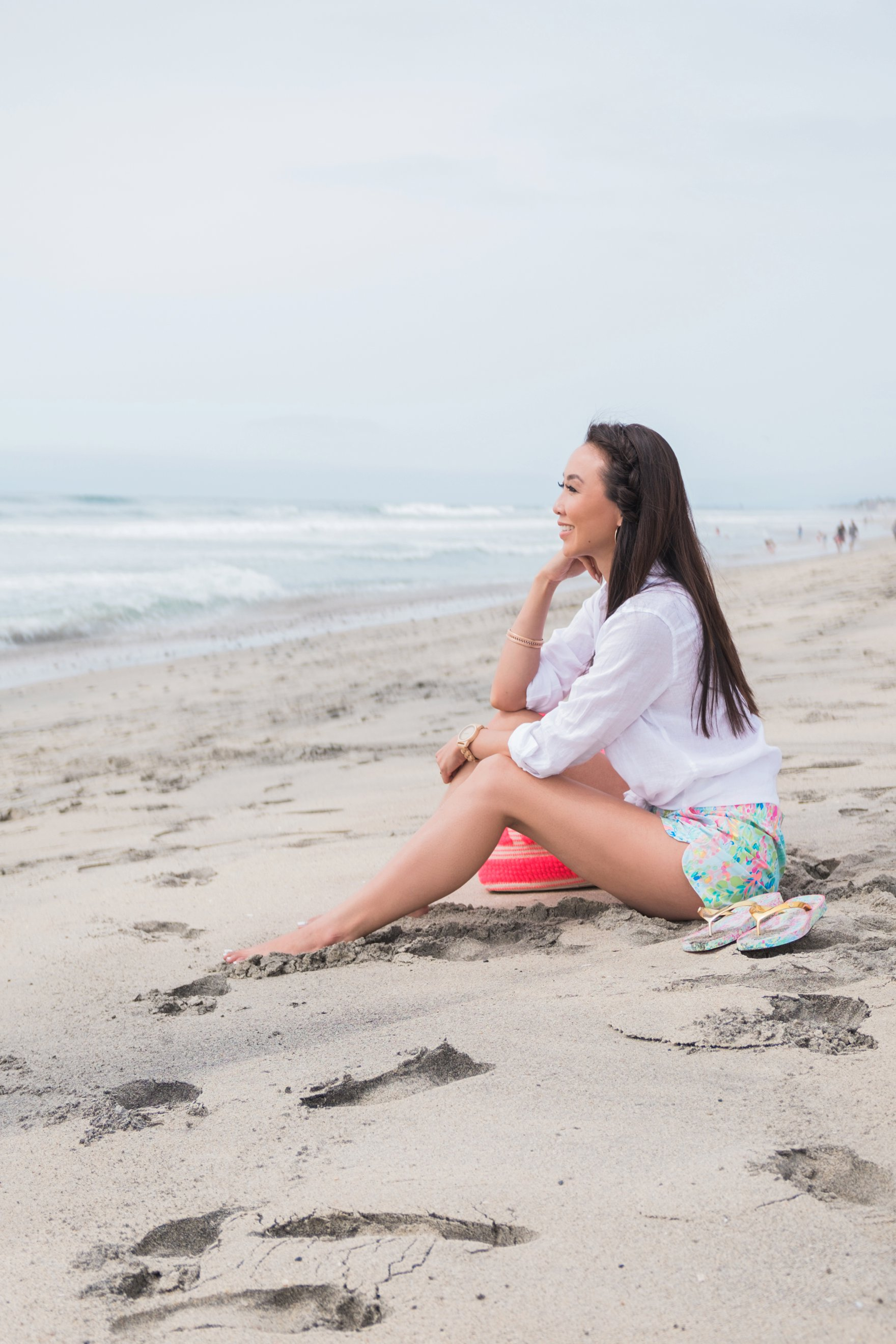 Carlsbad state beach wearing Lilly Pulitzer ocean view boardshort Diana Elizabeth blogger sitting on beach