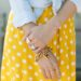 Yellow and white polka dot dress forever 21 paired with a chambray top featuring India hicks bracelet and other jewels