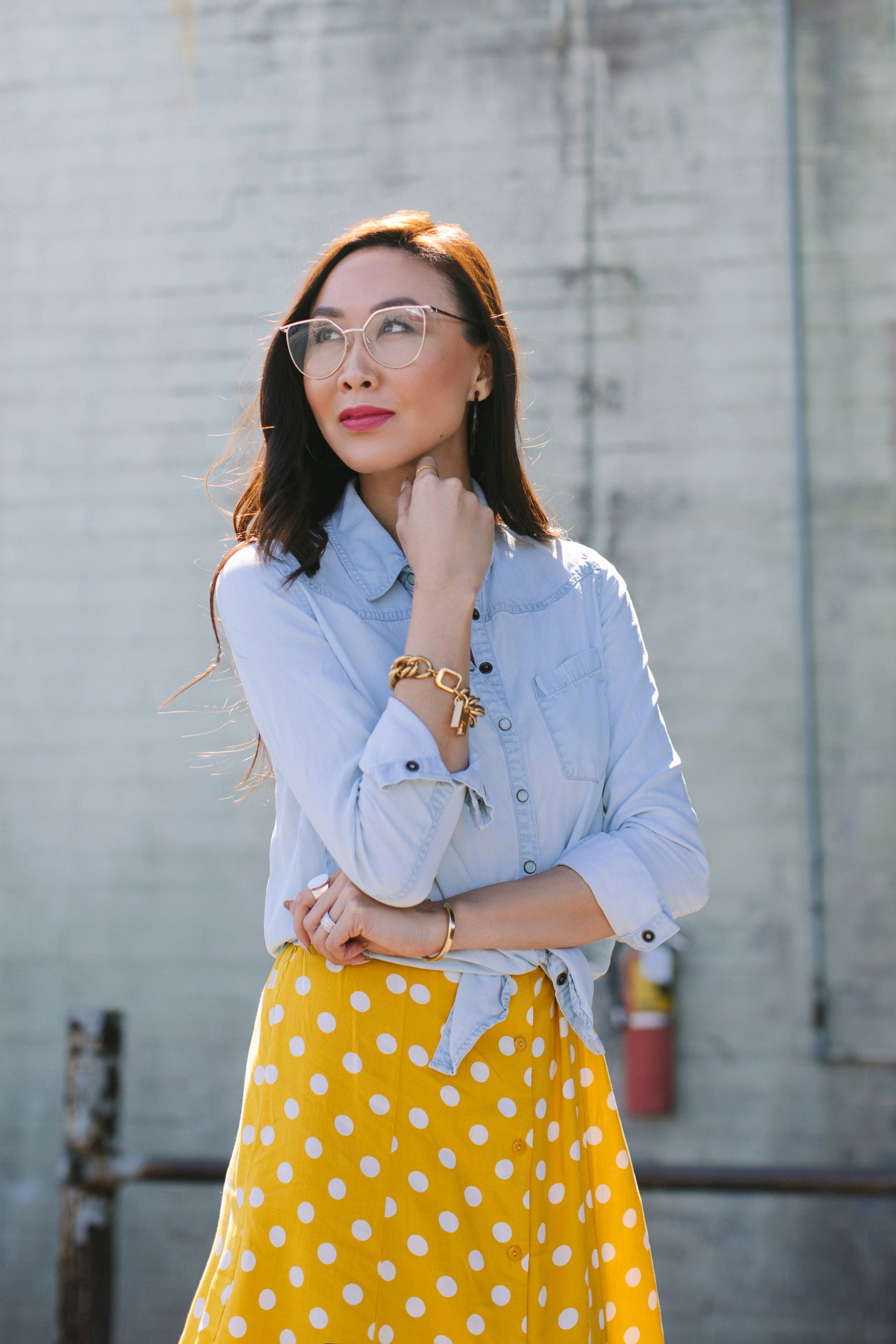 Yellow and white polka dot dress forever 21 paired with a chambray top featuring India hicks bracelet and other jewels lifestyle blogger Diana Elizabeth also wearing clear sunglases