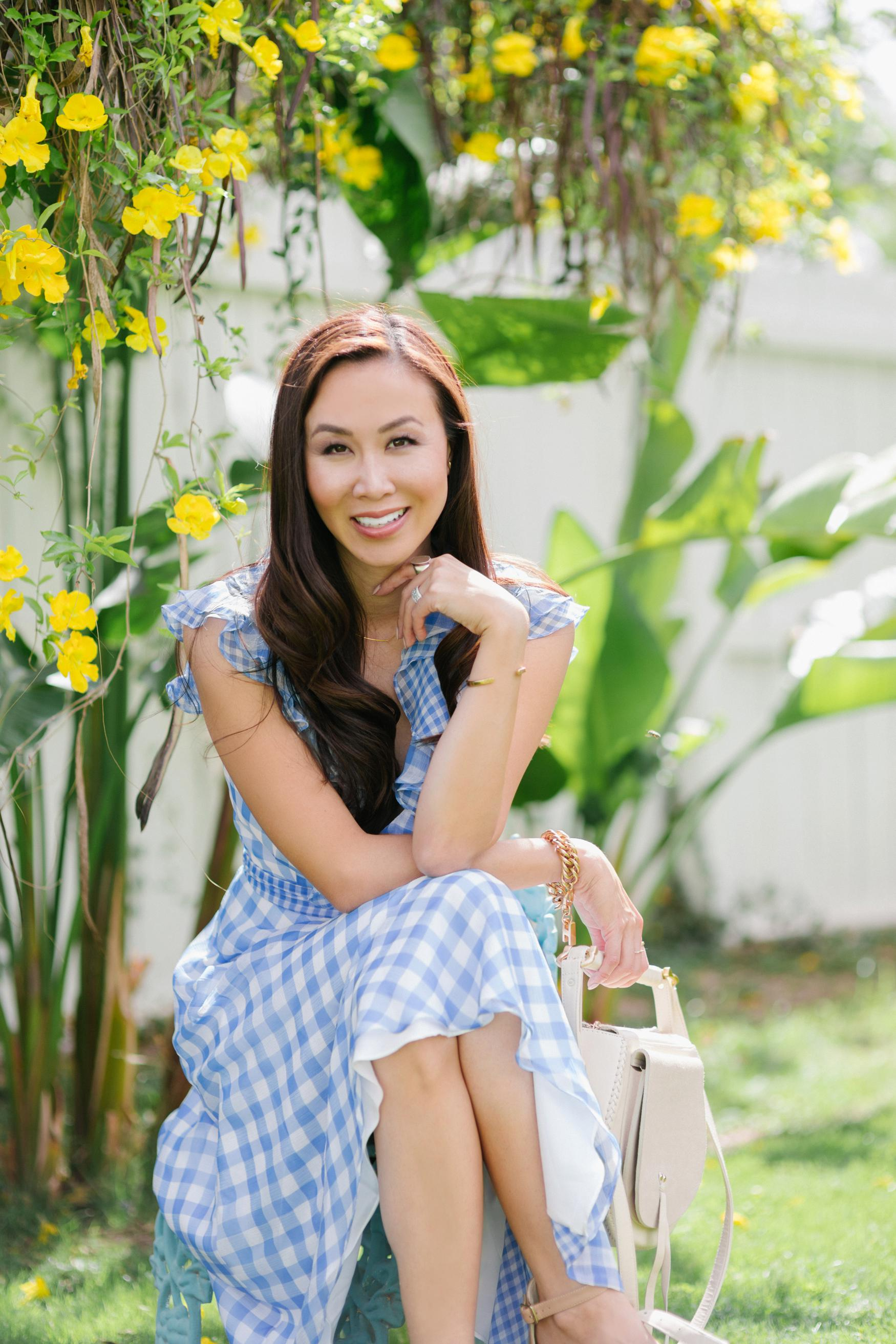 blue check ruffled gingham spring time dress by Tahari ASL // Phoenix Style Lifestyle Blogger Diana Elizabeth in front of white painted fence with yellow flowers cat's claw vines