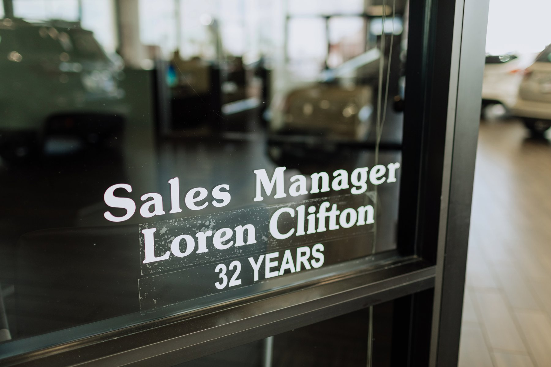 32 years with the company Sanderson Ford decal on the employee office window