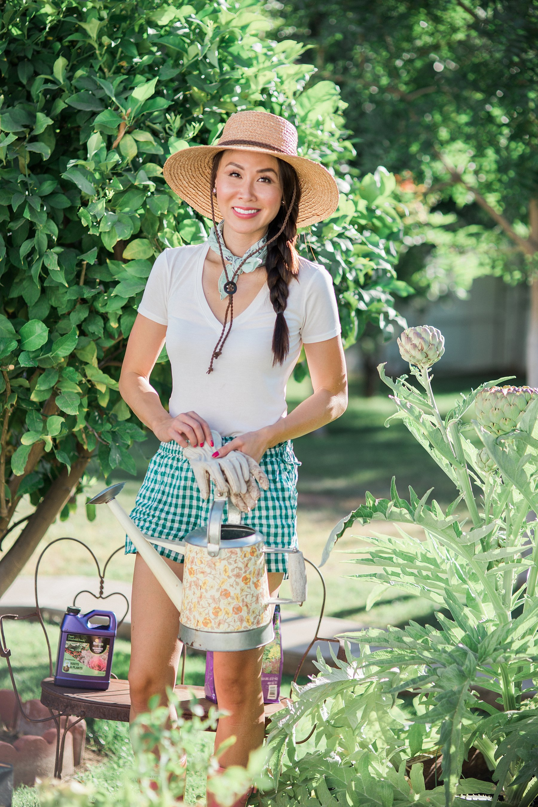 In the backyard garden with lifestyle blogger home and garden lover blogger: With BioFlora organic fertilization for gardens and shrubs and trees a review // about to water the raised garden beds