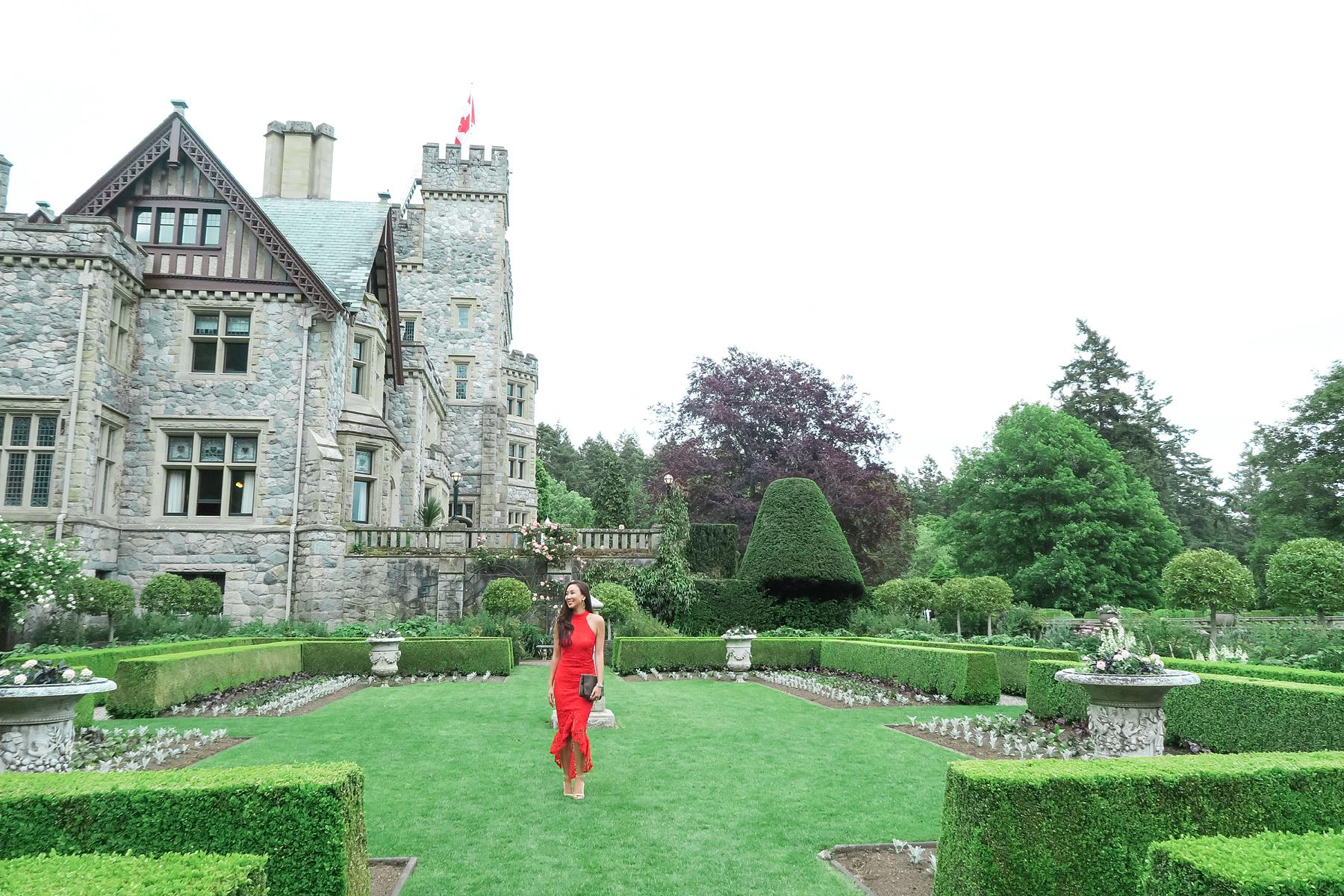wedding at hatley castle wedding in Victoria Canada wearing a red lace dress like the emoji