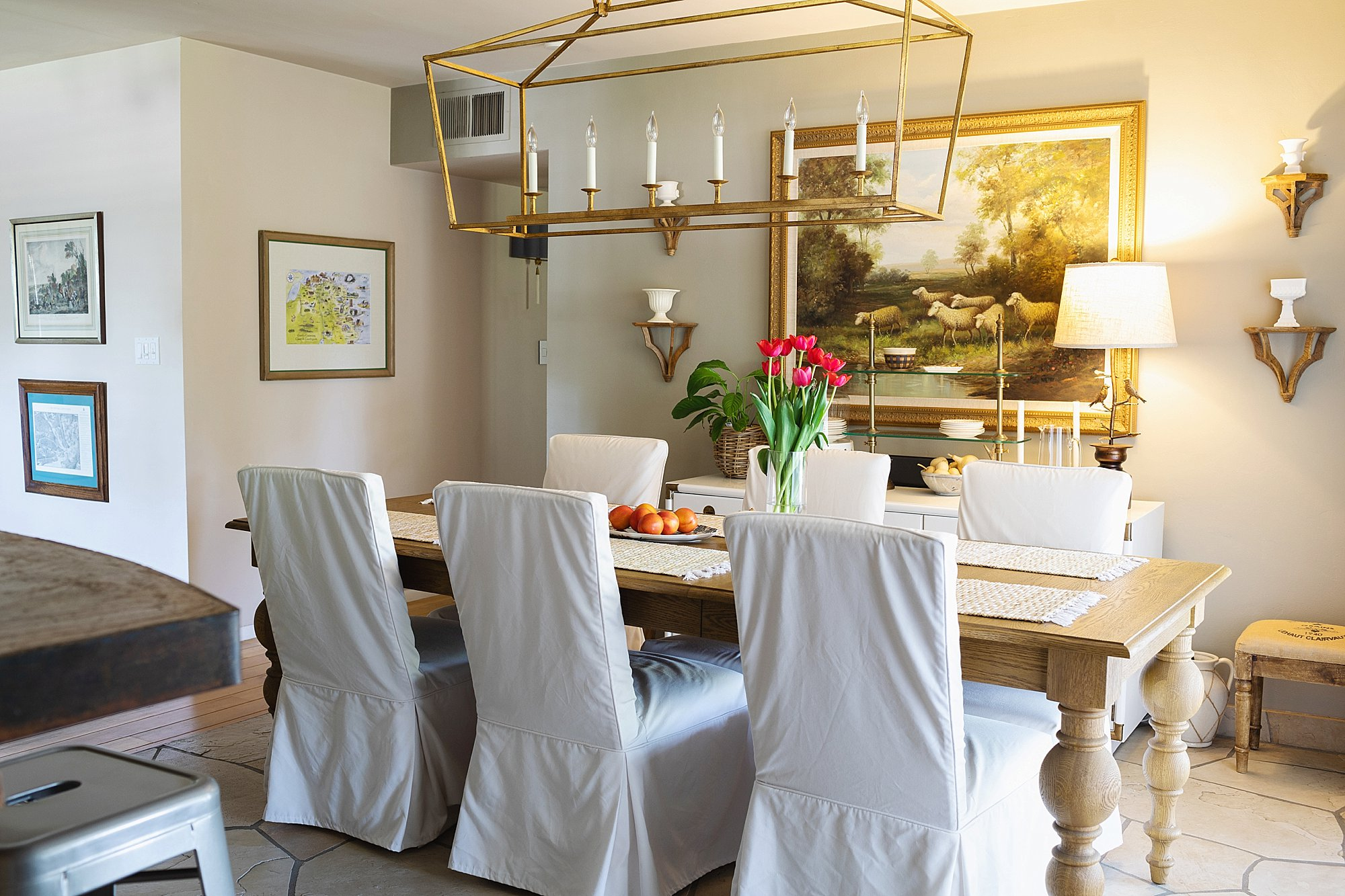 Dining room with rolling chairs from Ballard Designs and Restoration Hardware dining room table.