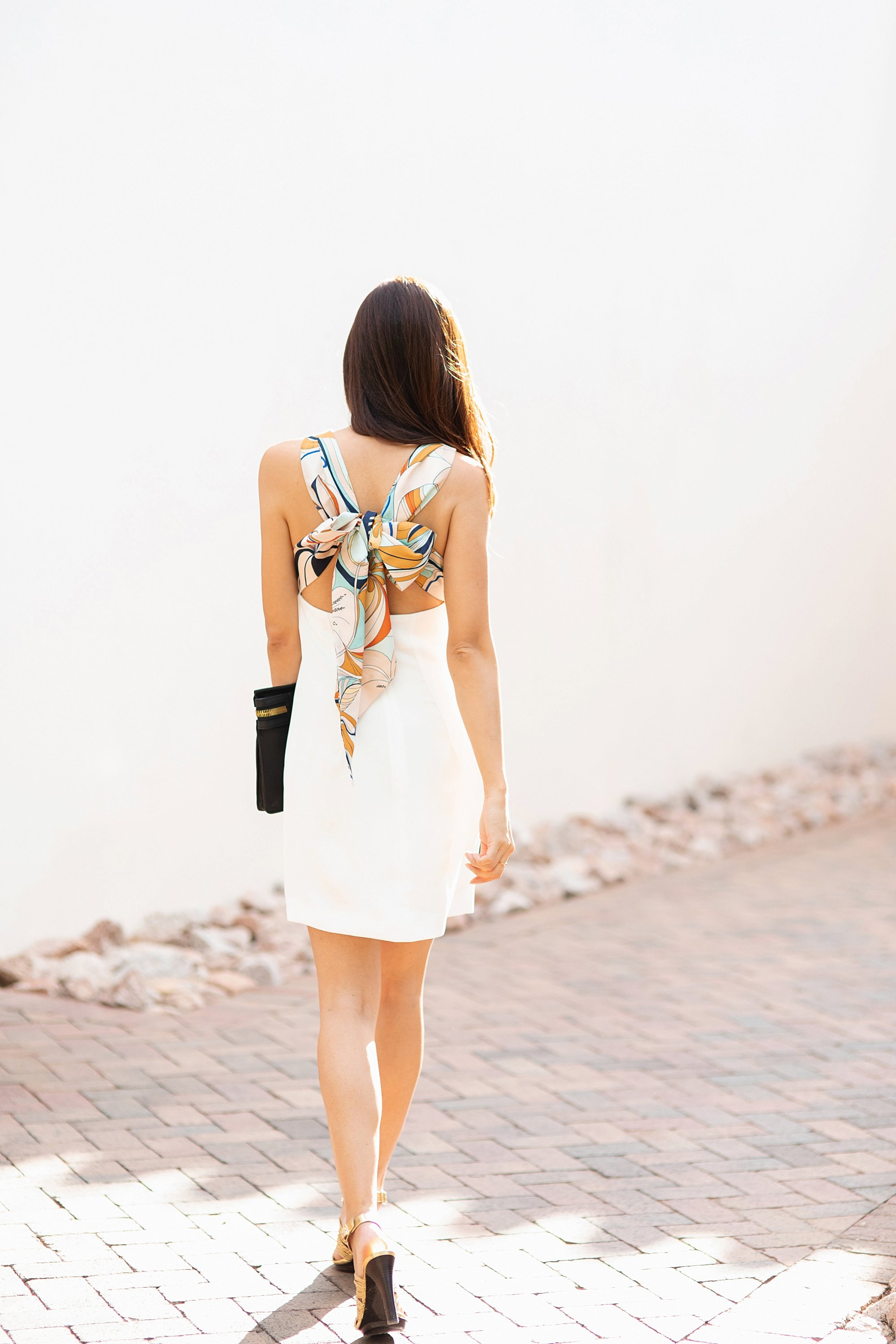 Mango Gugi2 scarf dress on blogger Diana Elizabeth in Phoenix, Arizona. Scarf dress paired a black clutch by India Hicks and white leather brass cuff back of her walking away to Heard Museum