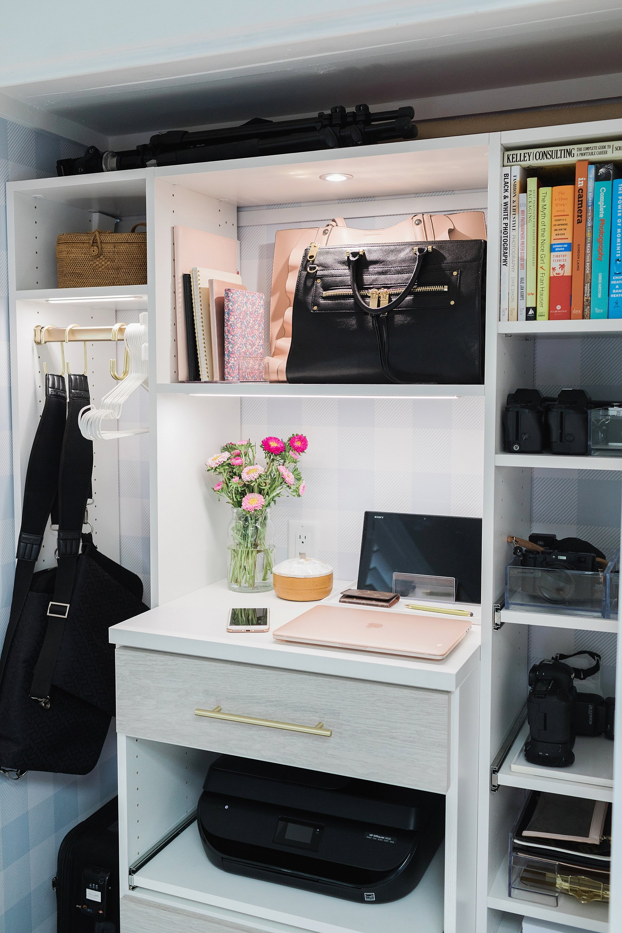 AFTER photos: final reveal of office closet reveal belonging to photographer blogger Diana Elizabeth in phoenix arizona. created by California closets and with removable buffalo check wallpaper #office #closet #wallpaper #organization #lensorganization #lensdrawer