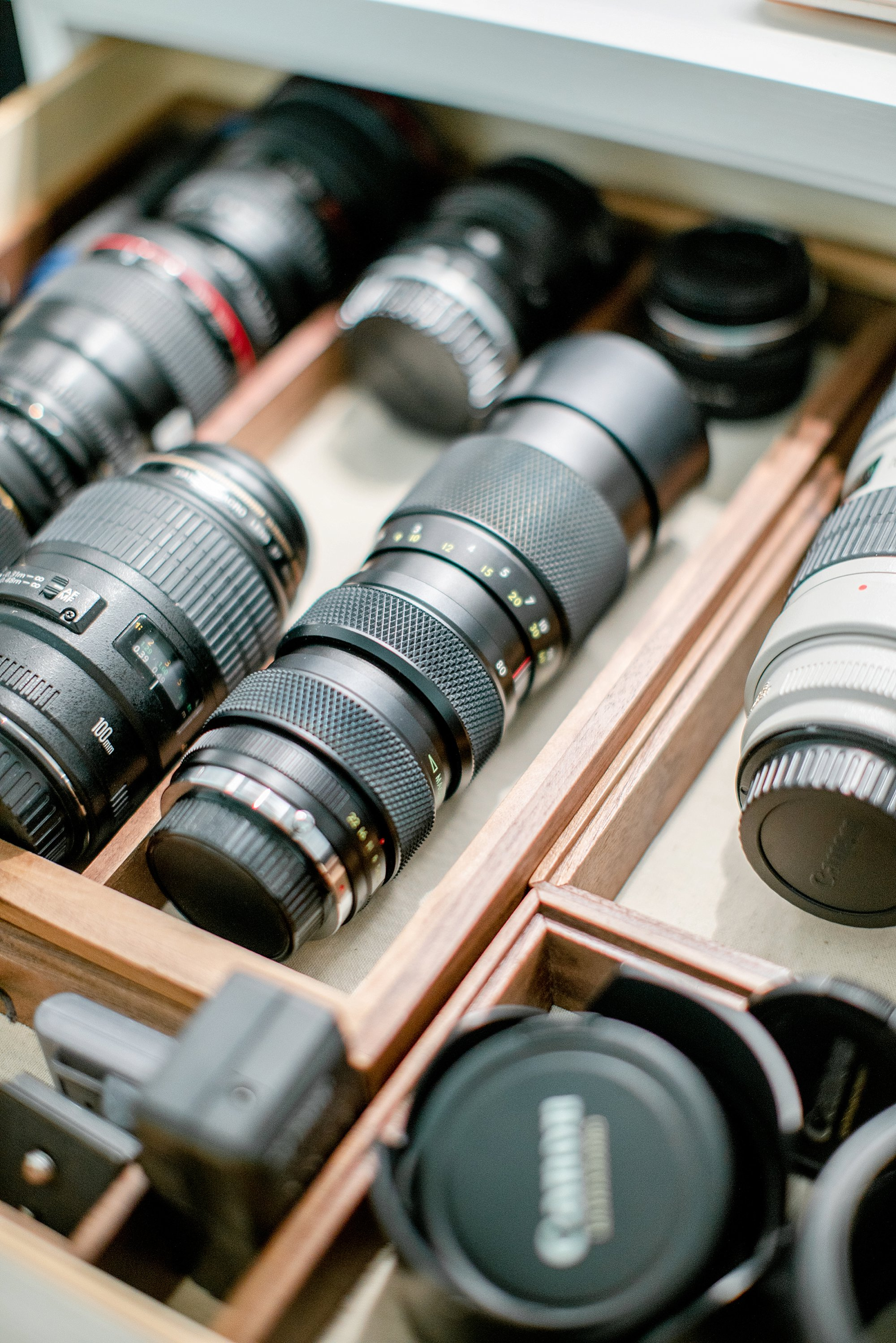 camera lens drawer organization for photographers, check out the office closet reveal to organize camera equipment #photography #office #closet